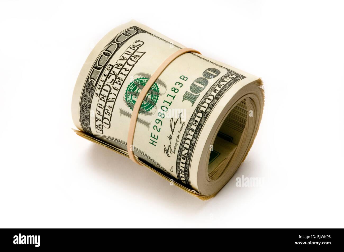 roll of dollar bills on white - Stock Image