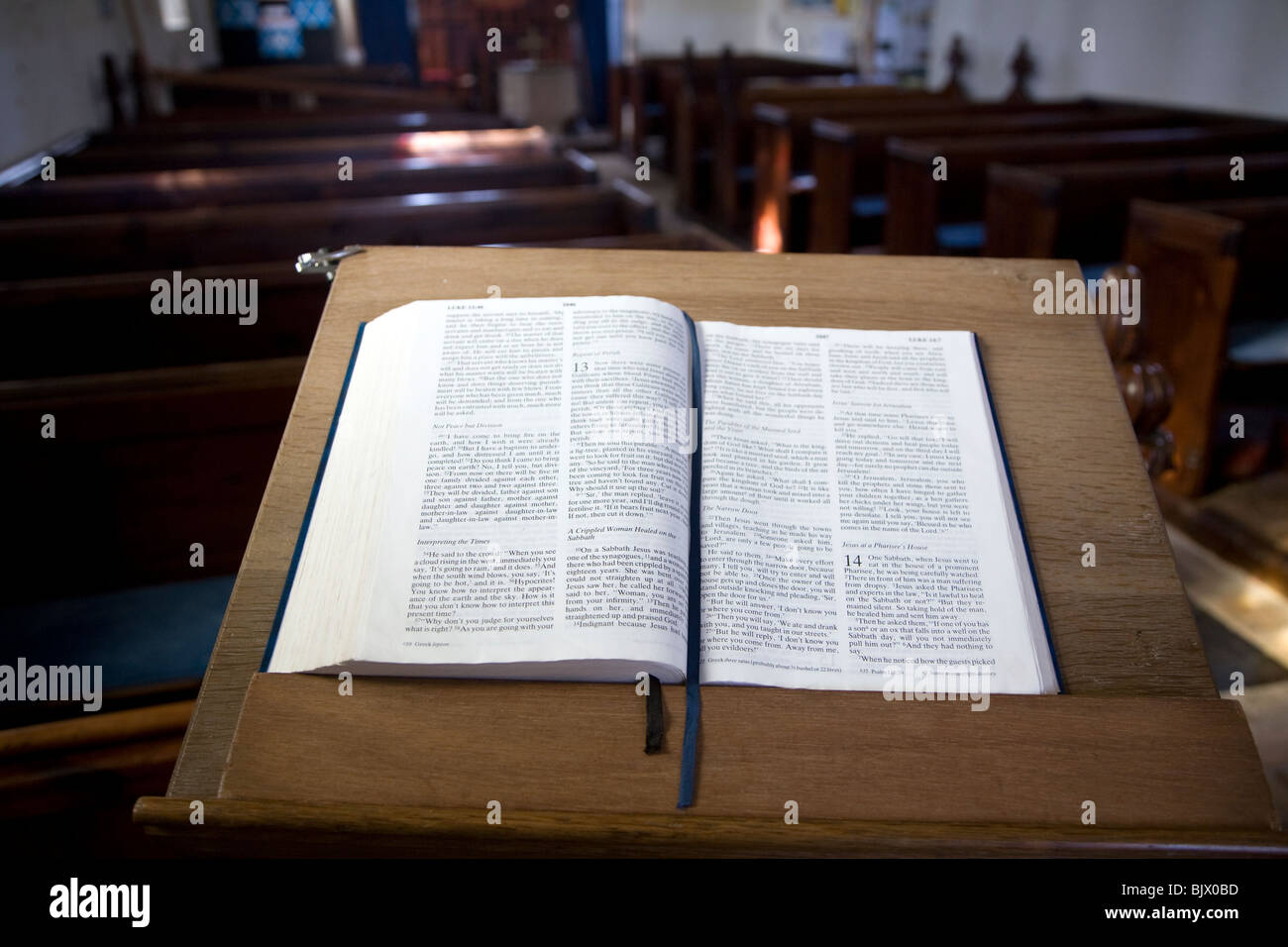 Open bible book on lectern in small empty church All Saints and St Margaret's church, Chattisham, Suffolk - Stock Image