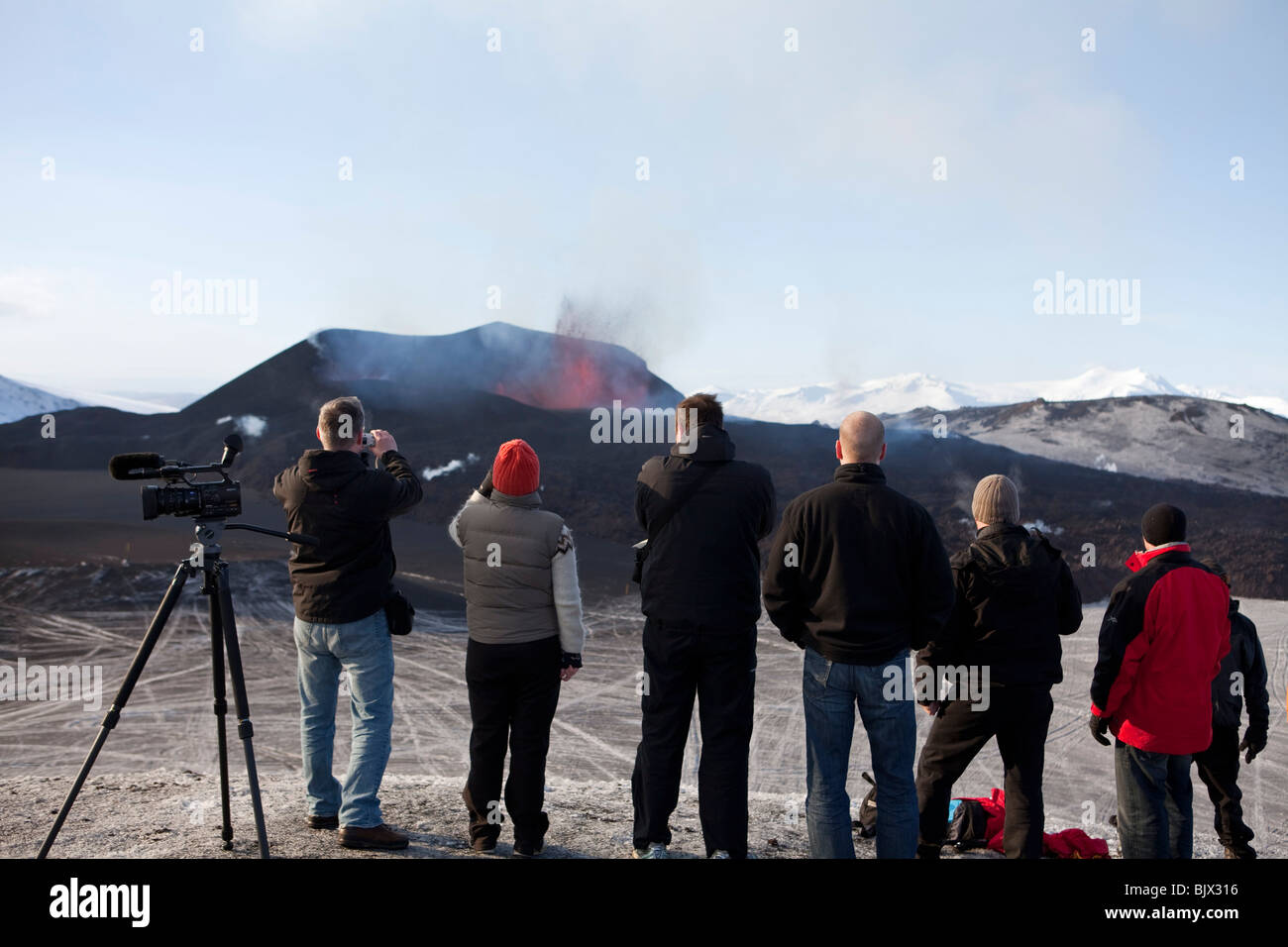 group of people watching the volcanic eruptionat Fimmvorduhals in Eyjafjallajokull, Iceland - - Stock Image