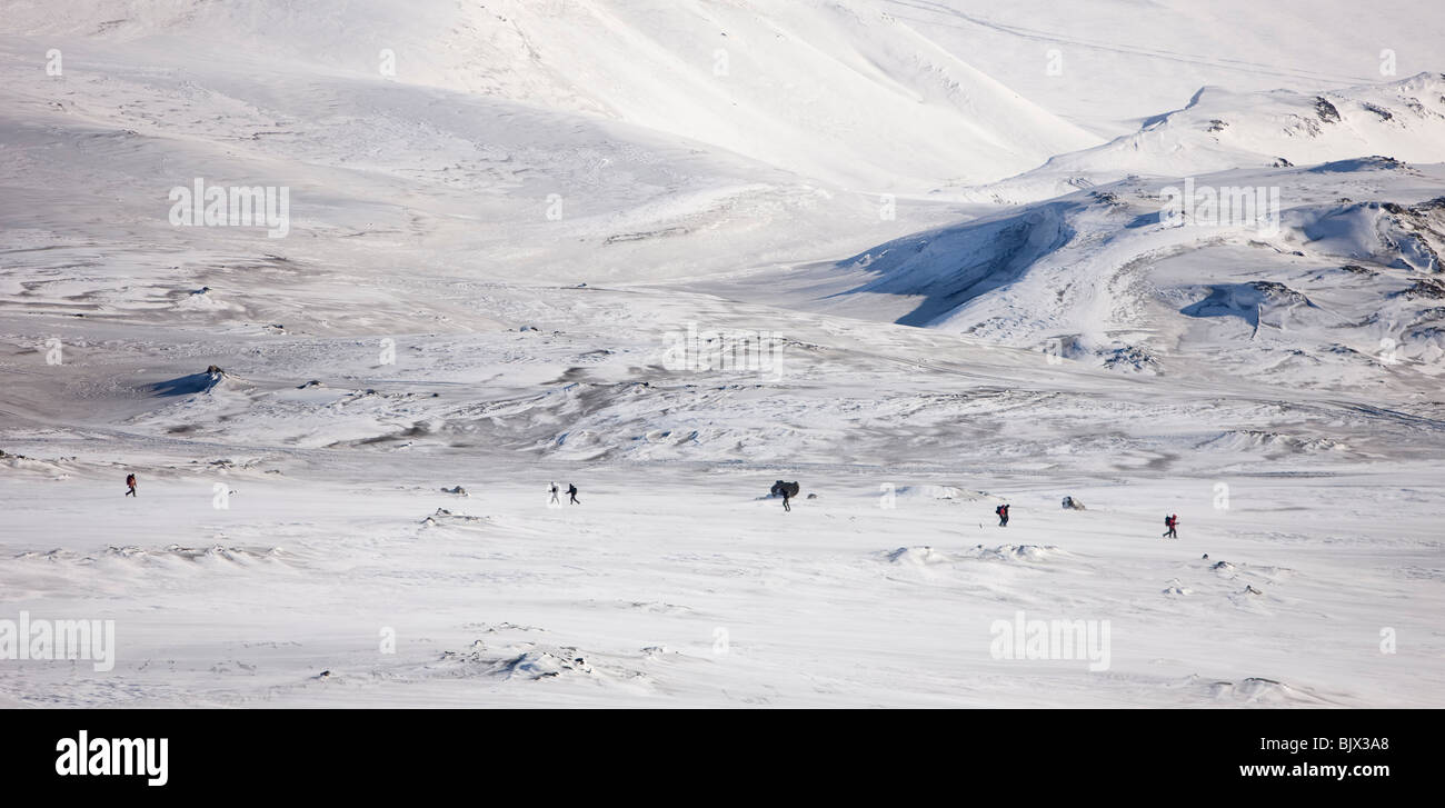 People walking towards the volcanic area in Fimmvorduhals, Iceland - - Stock Image