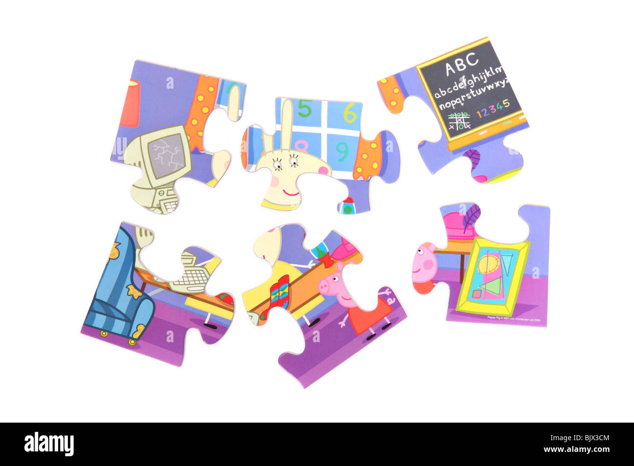 A Pepper Pig jigsaw puzzle, taken against a white background. - Stock Image