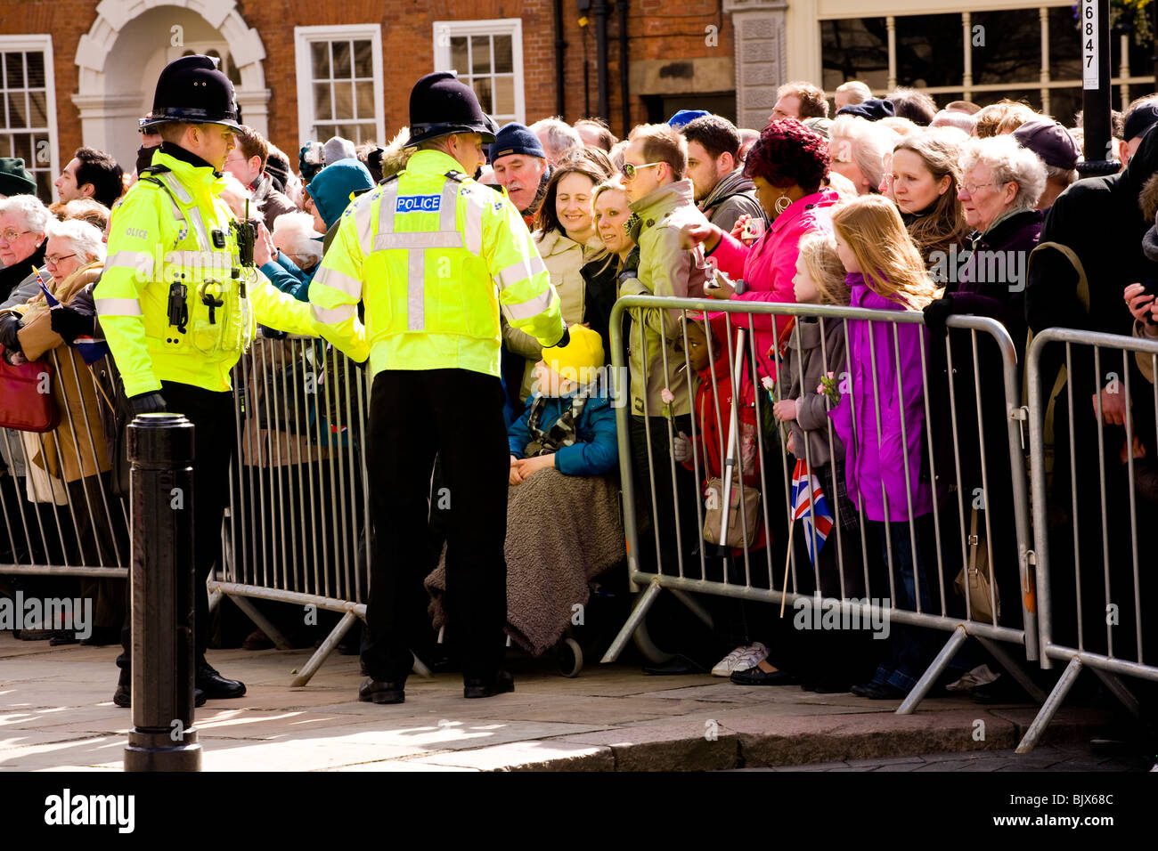 Police open crowd barrier at Derby Cathedral when the Queen is attending Maundy Ceremony so a disabled can child - Stock Image