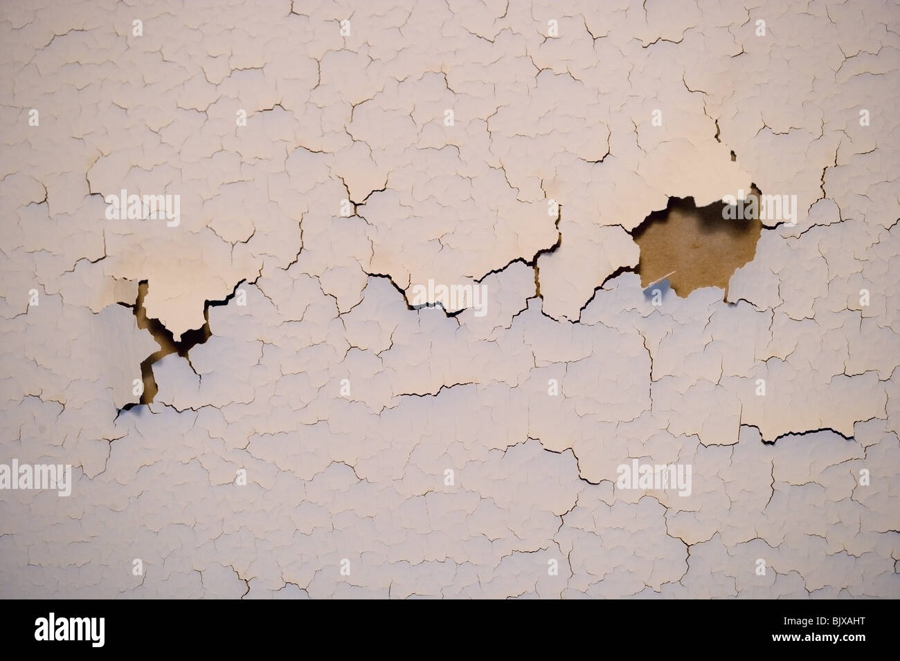 Paint cracking on an interior wall of a house. - Stock Image