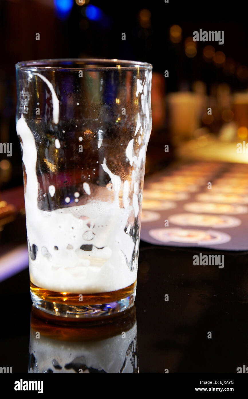 Pint glass on a bar - Stock Image