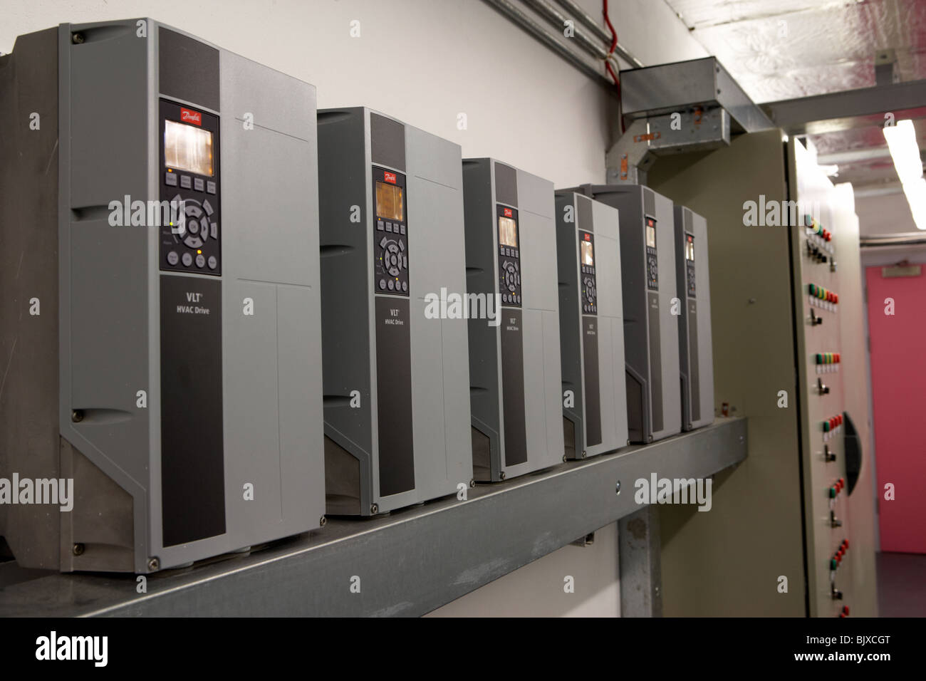 control panels for new installation hvac heating ventilation and air conditioning system in a modern office building - Stock Image