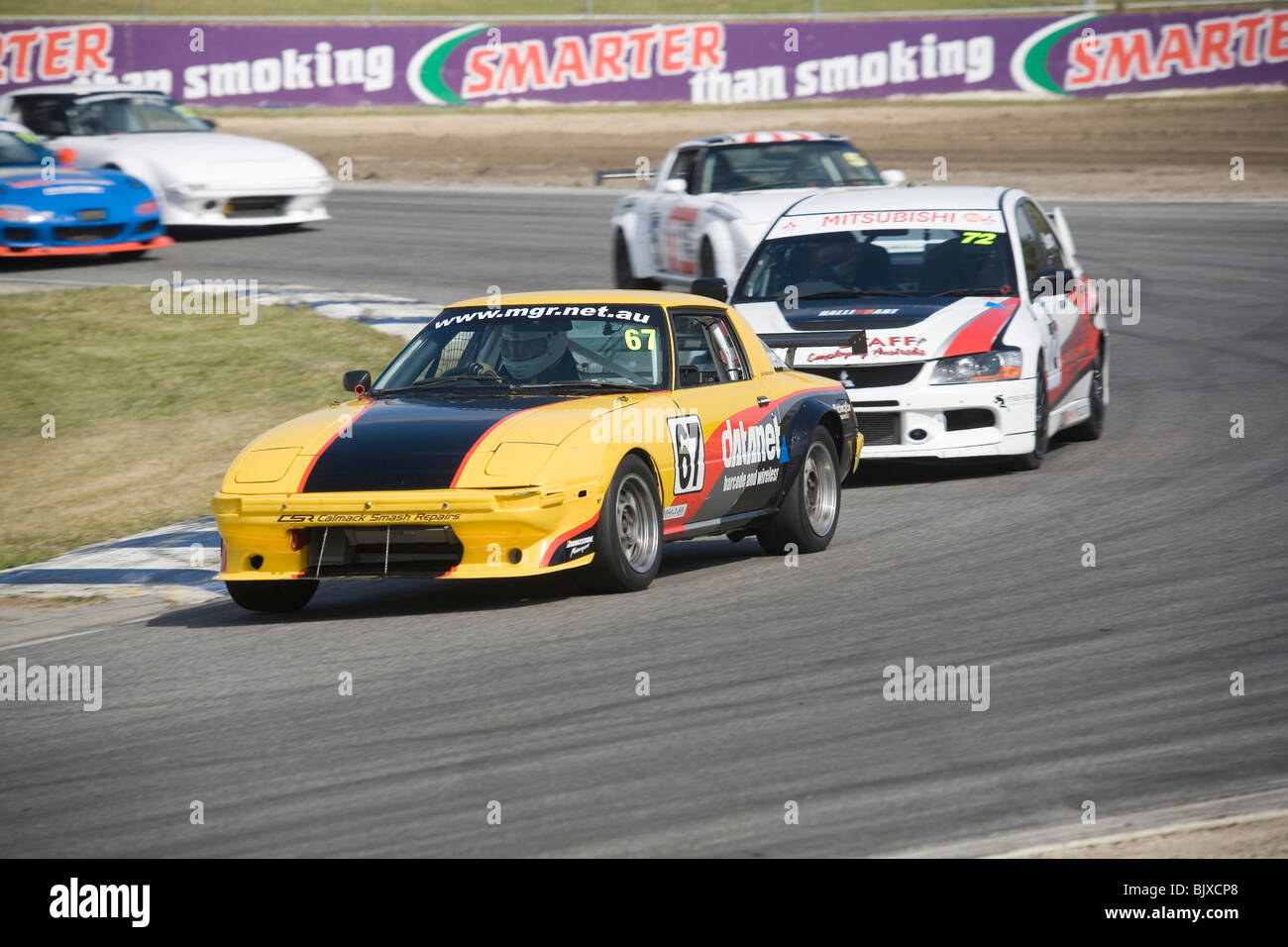 Mazda RX7 Race Car Leading The Pack Around A Corner   Stock Image