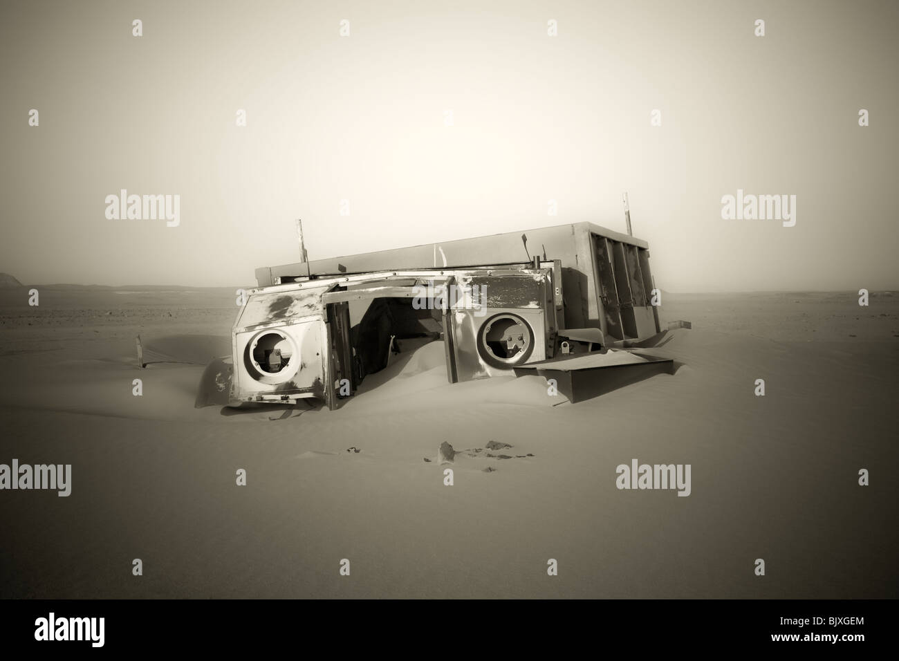 Monochrome image of abandoned Ford 30 CWT CMP truck from 1941/42 era sinking in the sand of the Western Desert, - Stock Image