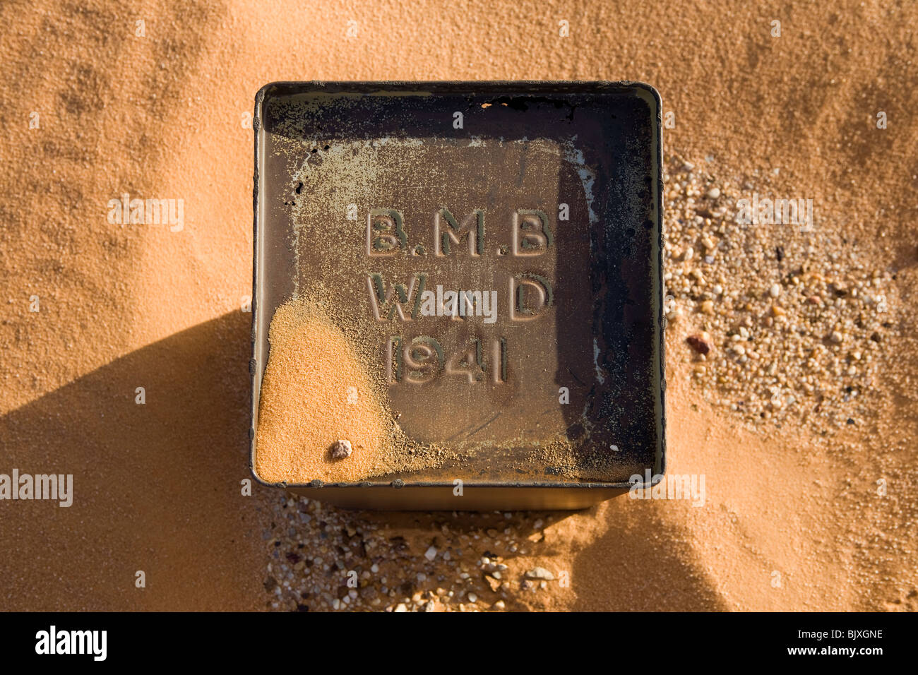 Fuel tin close to abandoned Ford 30 CWT CMP truck from 1941/42 era sinking in the sand of the Western Desert, Egypt - Stock Image