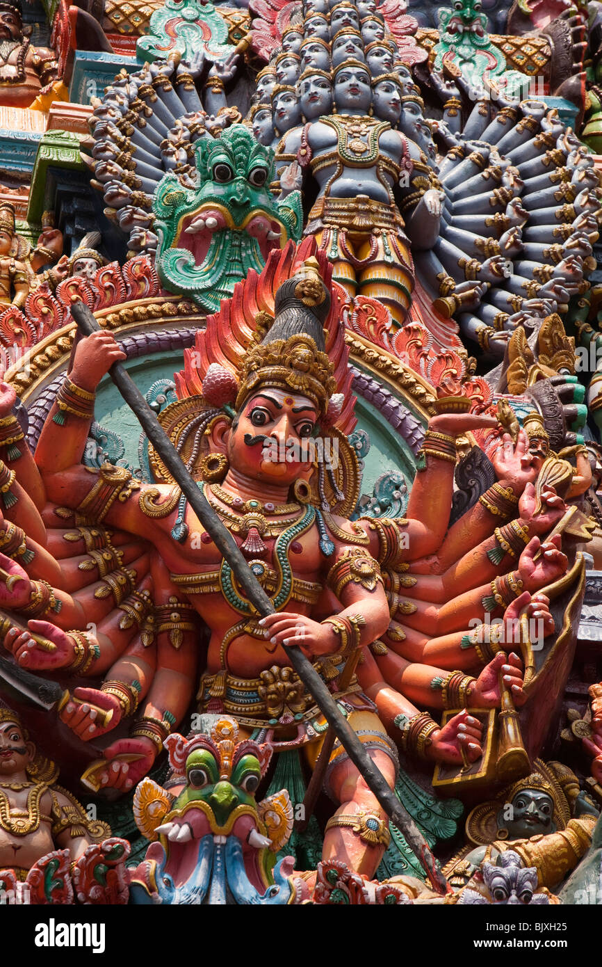 India, Tamil Nadu, Madurai, Sri Meenakshi Temple, newly restored west gopuram multi armed deity - Stock Image