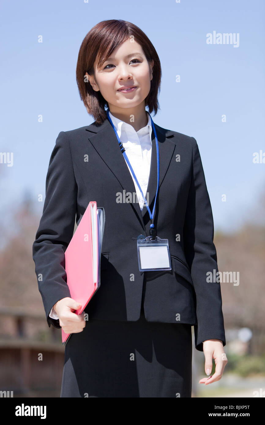 Young businesswoman holding files - Stock Image