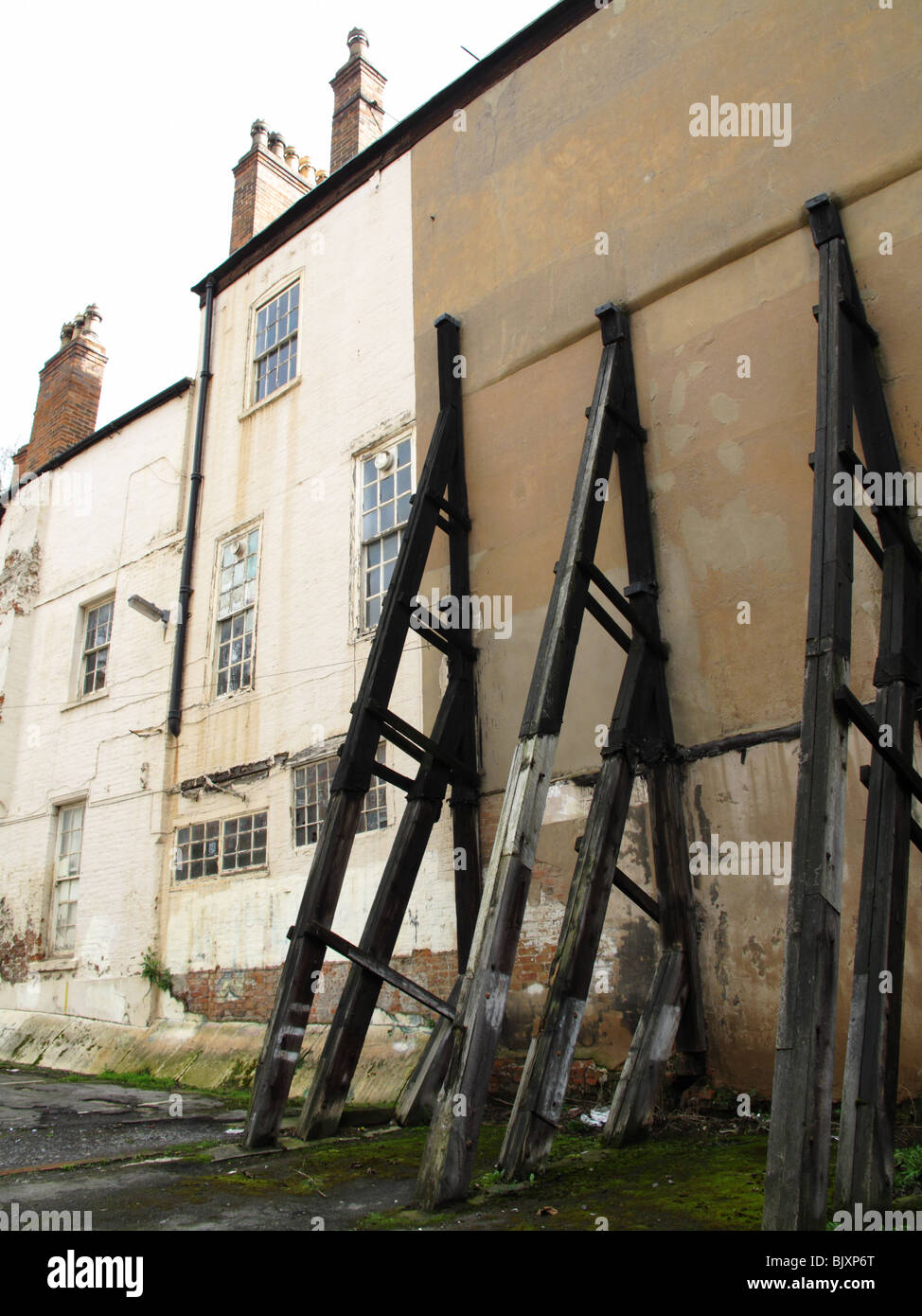 Structural supports on an old building in a U.K. city. - Stock Image