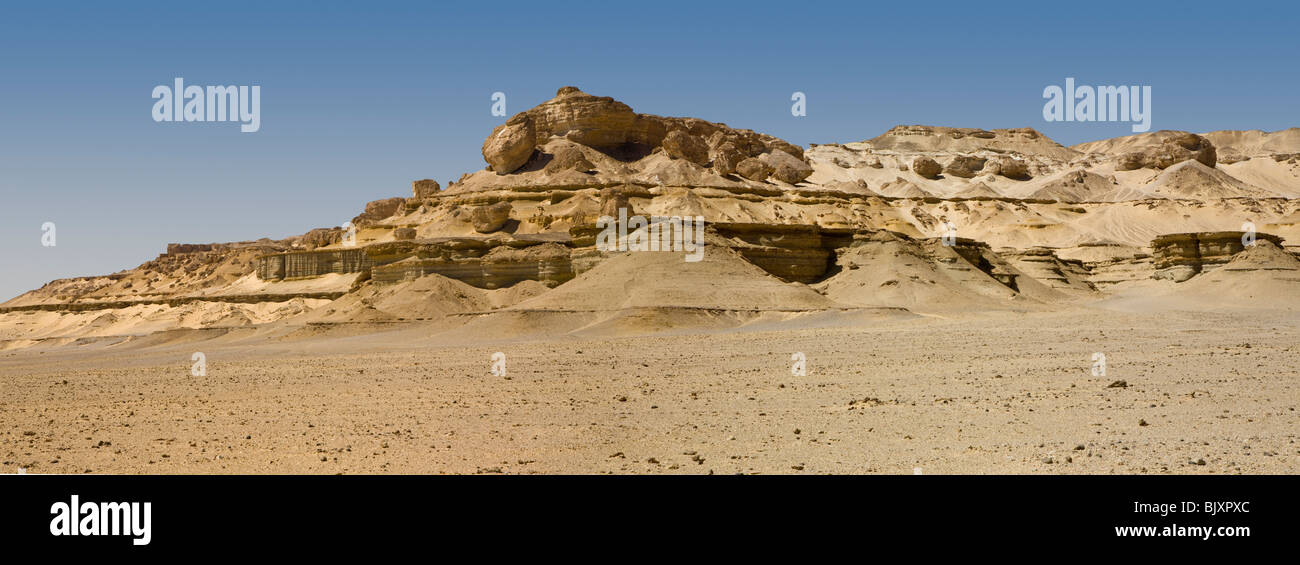 Panoramic shot of landscape showing shale layers in the Valley of The Whales, Wadi El-Hitan, Western Desert of Egypt - Stock Image