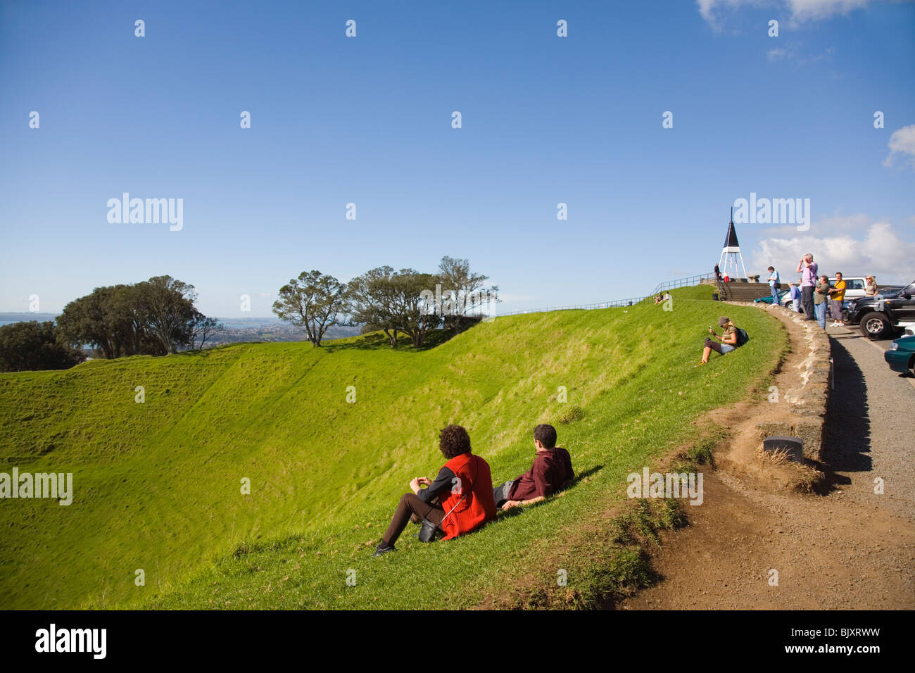Tourists at Mount Eden Domain (Maungawhau) summit car park on dormant volcanic crater. Auckland North Island New - Stock Image
