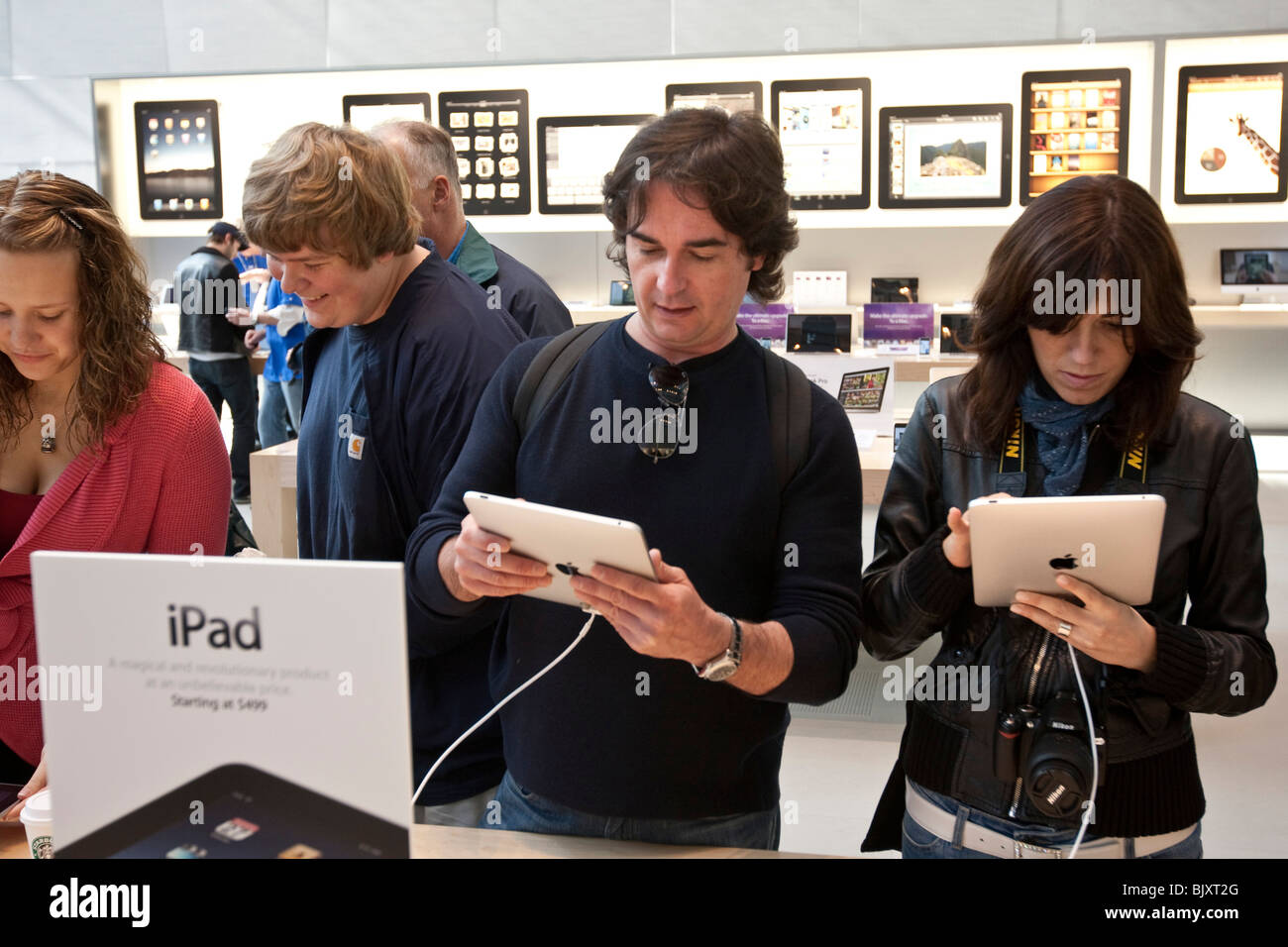 People try out the Apple iPad at the UWS Apple store in New York, USA, 3 April 2010. Stock Photo