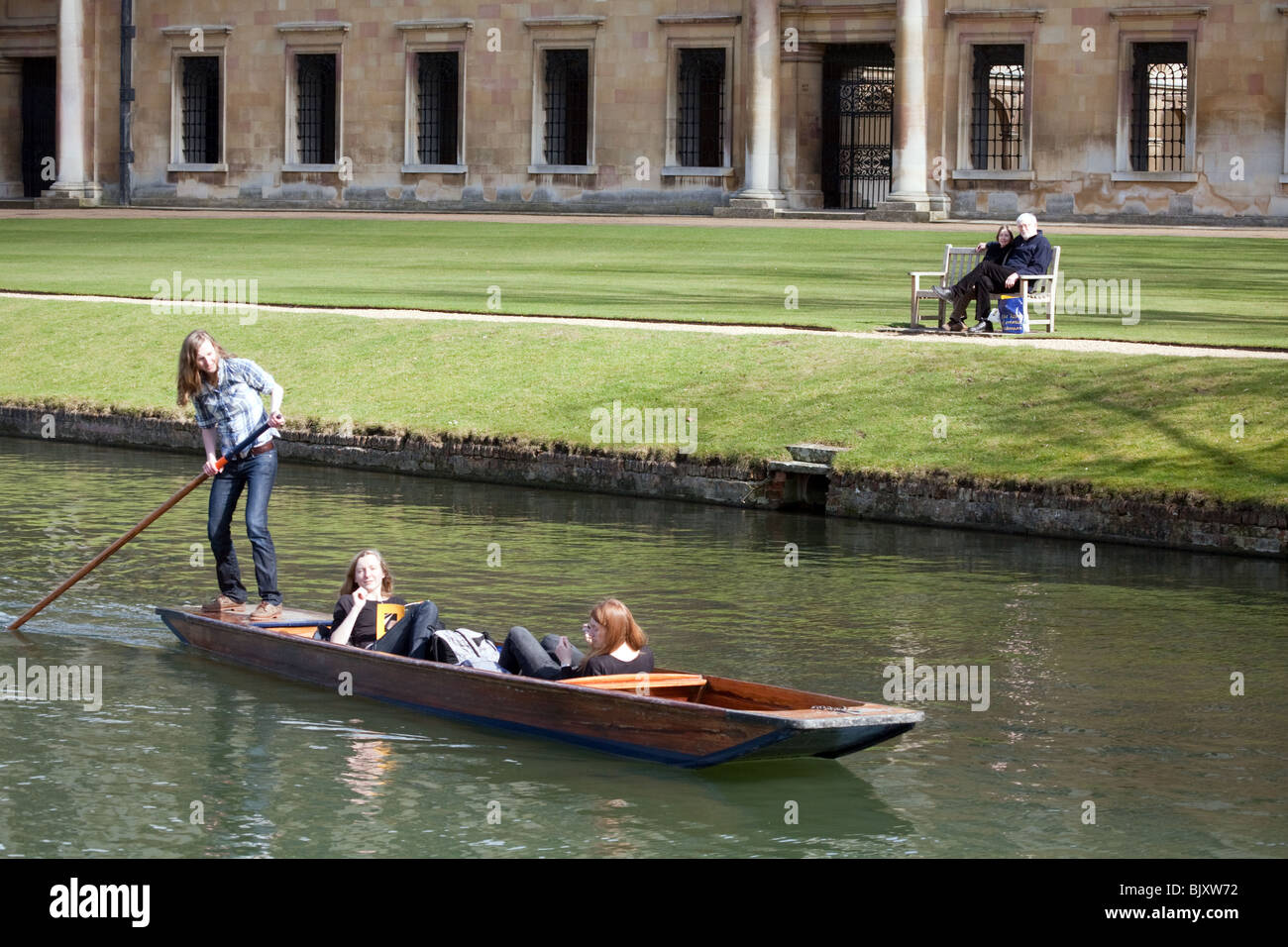 Punting on the River Cam past Nevile's Court, Trinity College in the background, Cambridge, UK - Stock Image