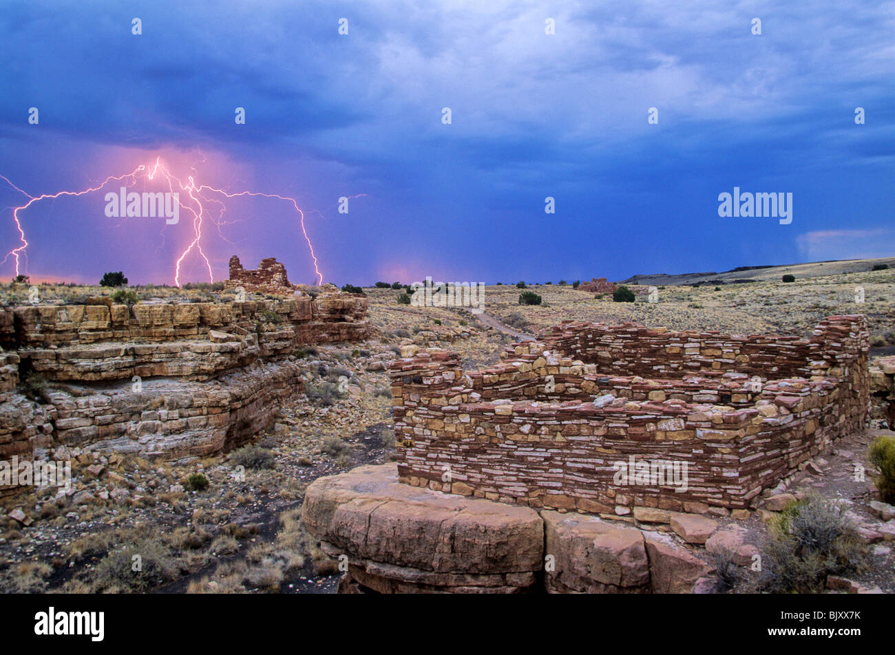 Summer thunderstorm with lightning at Lomaki Ruins, an ancient puebloan indian site at Wupatki National Monument, - Stock Image