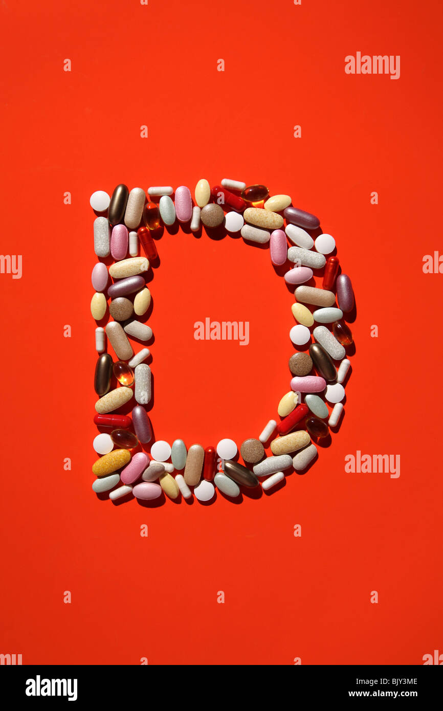 The shaped of the letter B formed with many colorful pills, tablets and capsules - Stock Image