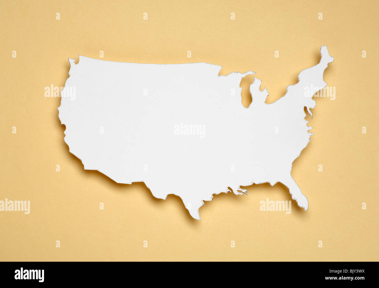 A cut out white paper outline of the United States of America Stock Photo