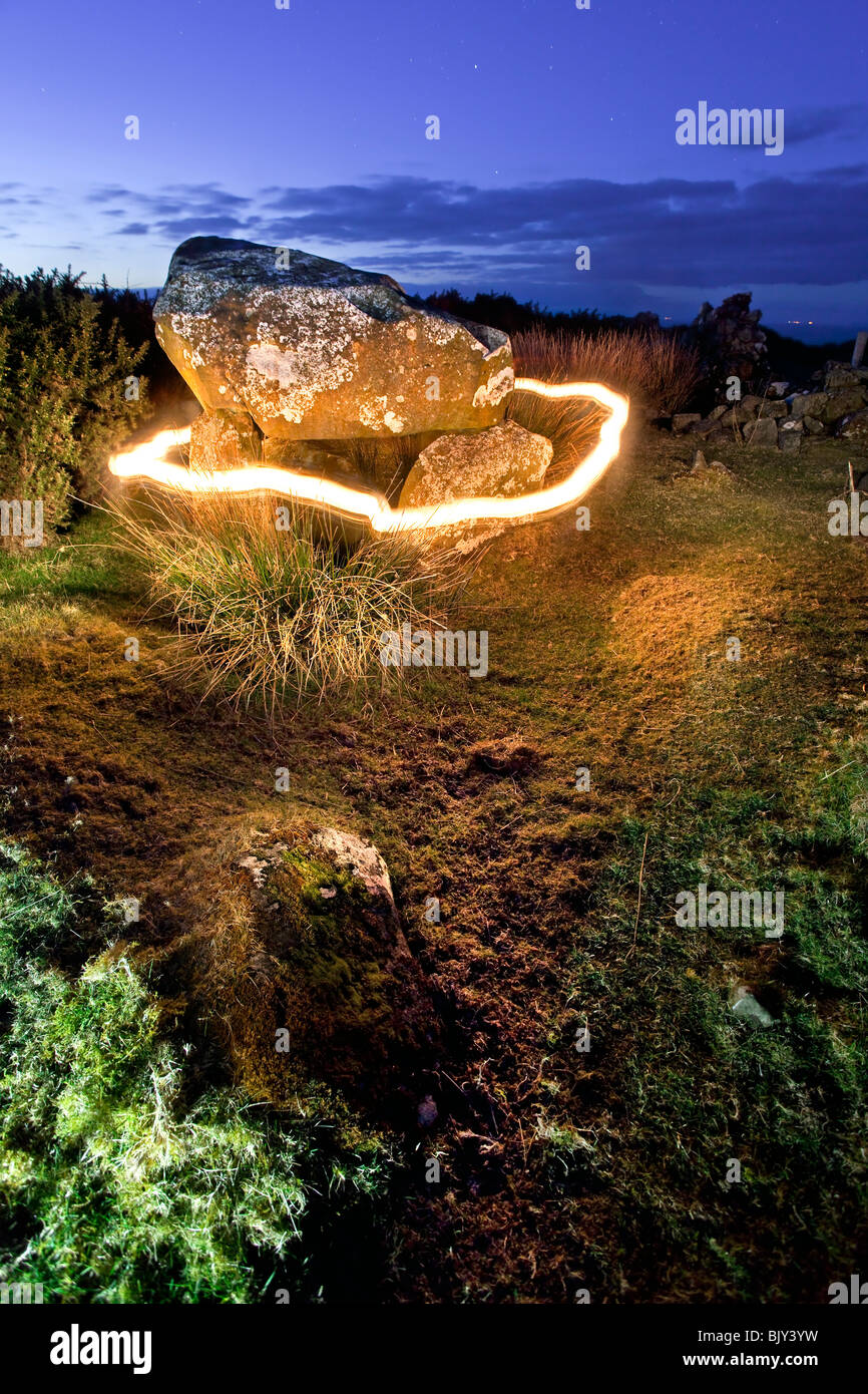 Ring of fire around Druid's Altar overlooking the Whitepark bay on the Antrim coast, Northern Ireland. - Stock Image