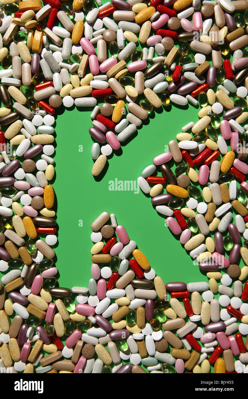 The shaped of the letter K formed with many colorful pills, tablets and capsules - Stock Image