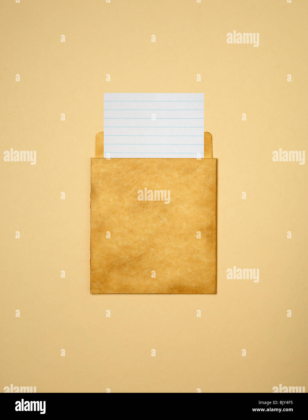 A  blank library card and pocket from a book - Stock Image