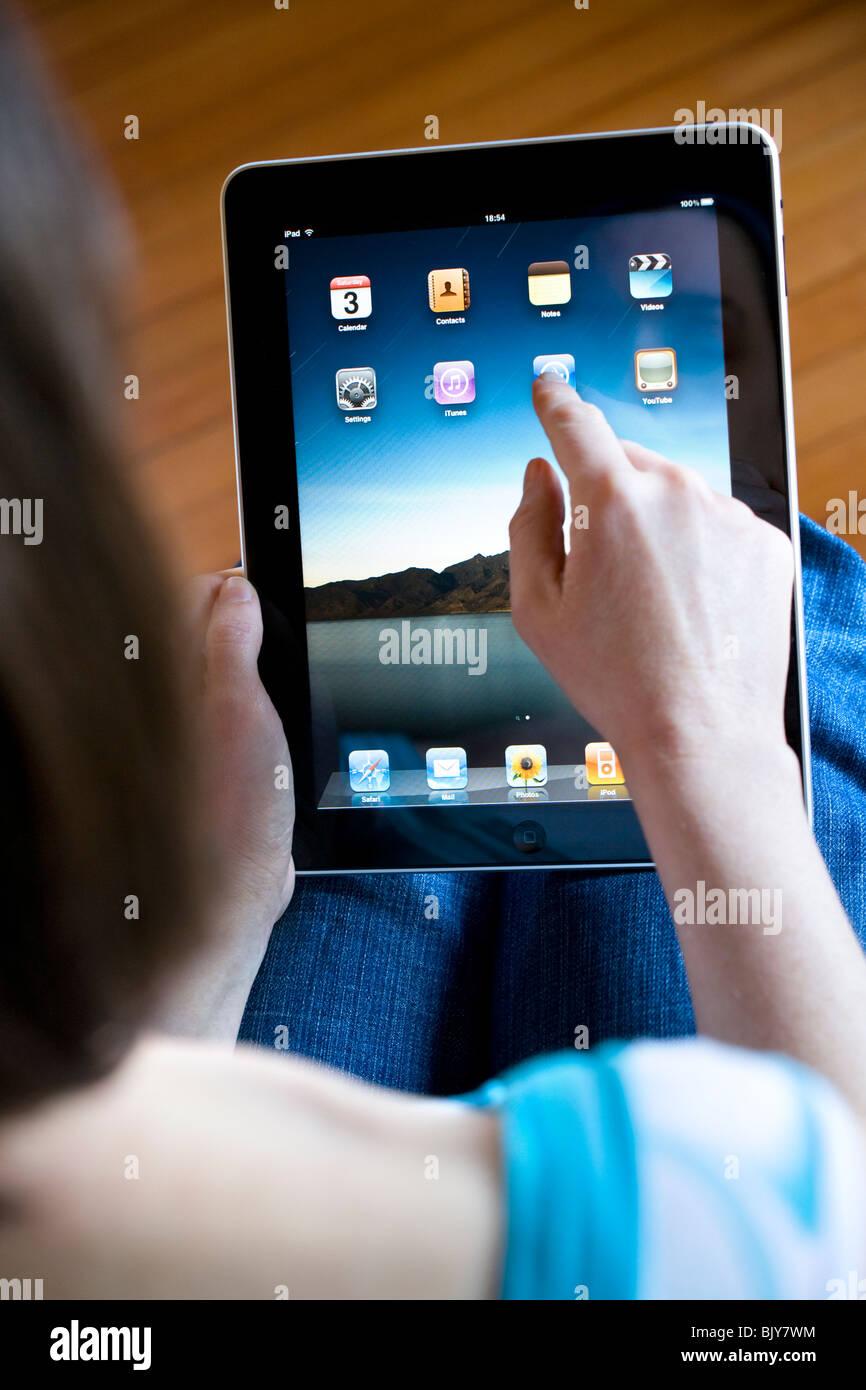 An apple mac ipad being used - Stock Image