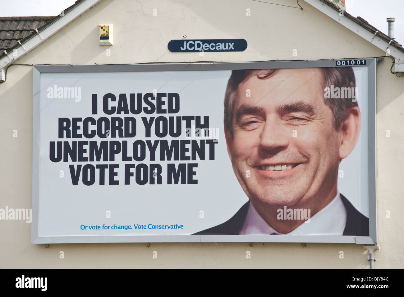 Conservative Party 2010 General Election billboard featuring Gordon Brown at JCDecaux site on end of terraced house - Stock Image