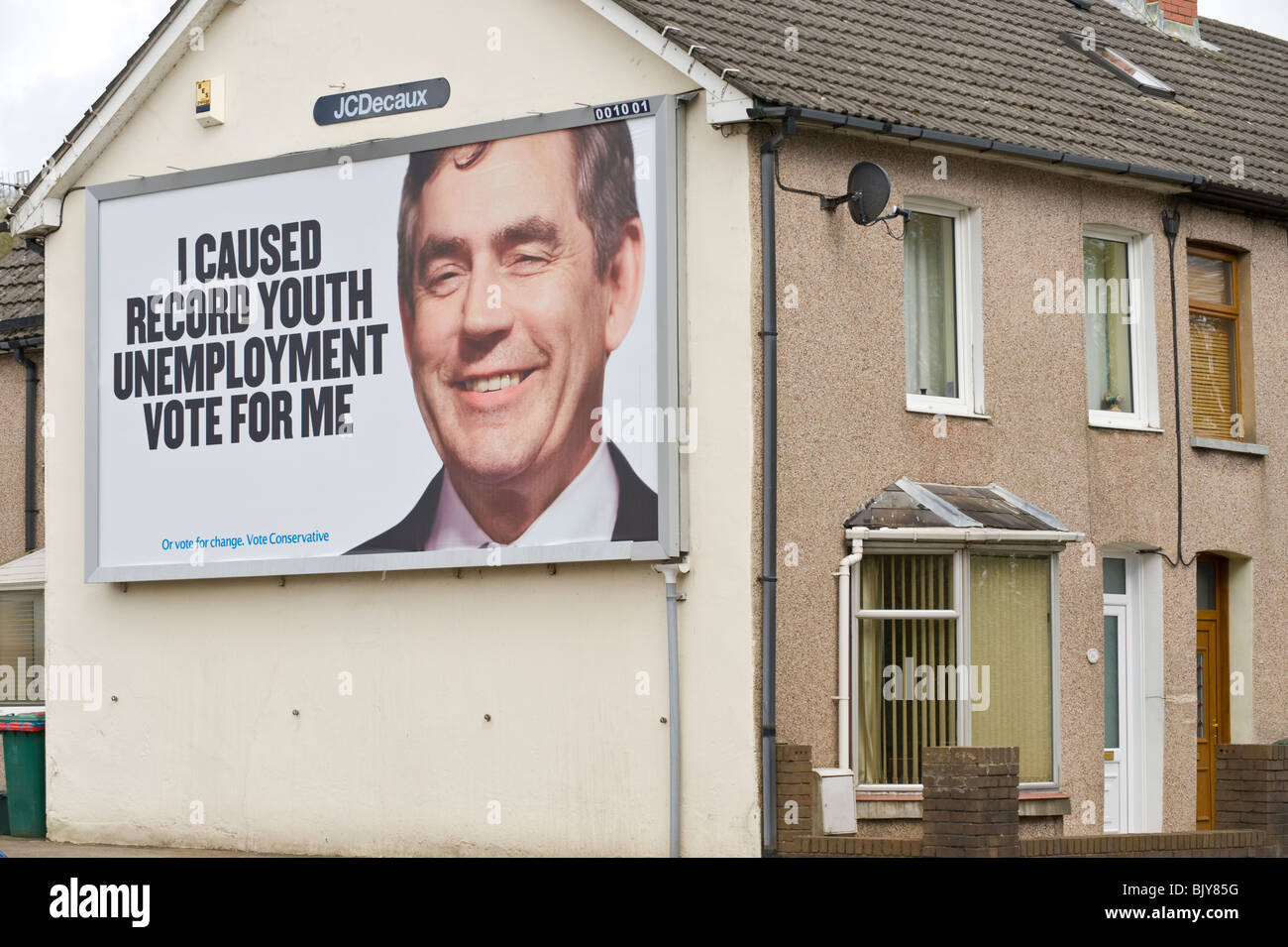 Conservative Party 2010 General Election billboard at JCDecaux site on end of terraced house in Newport South Wales - Stock Image