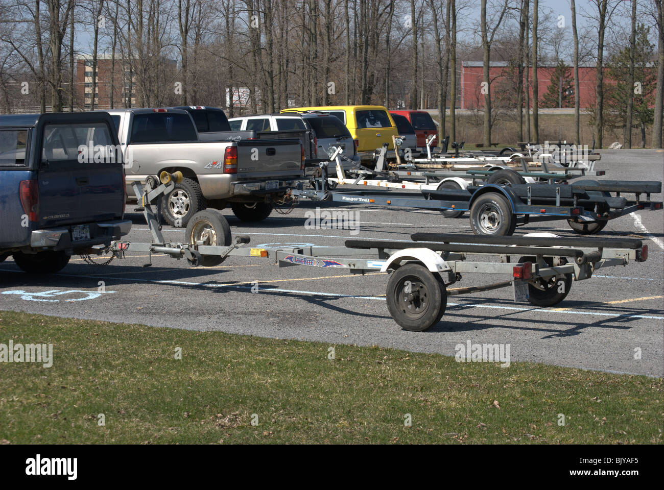 Boat Trailers parked at State launching for recreational boaters. - Stock Image