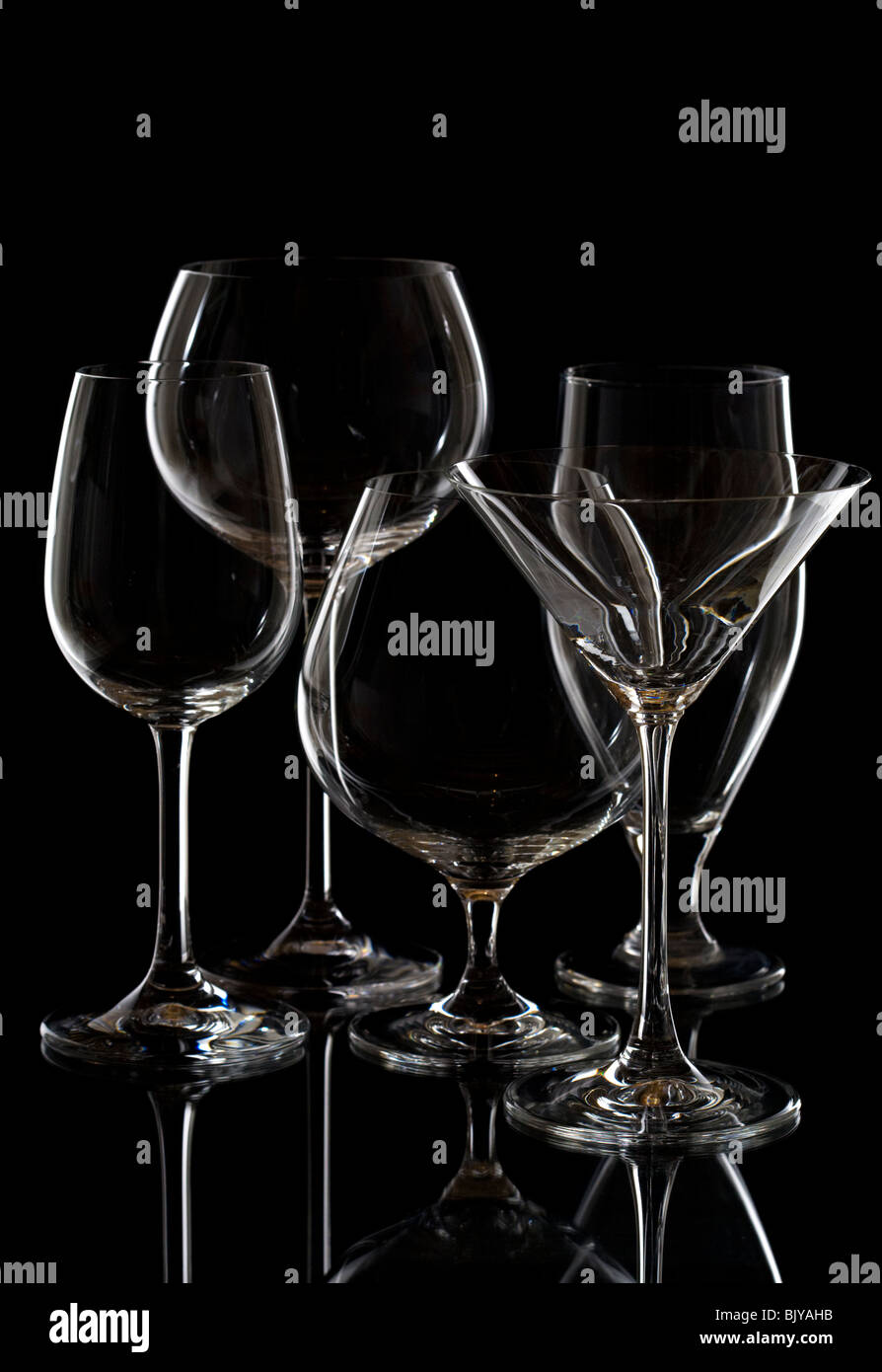 Set of bar glassware isolated on black background - Stock Image