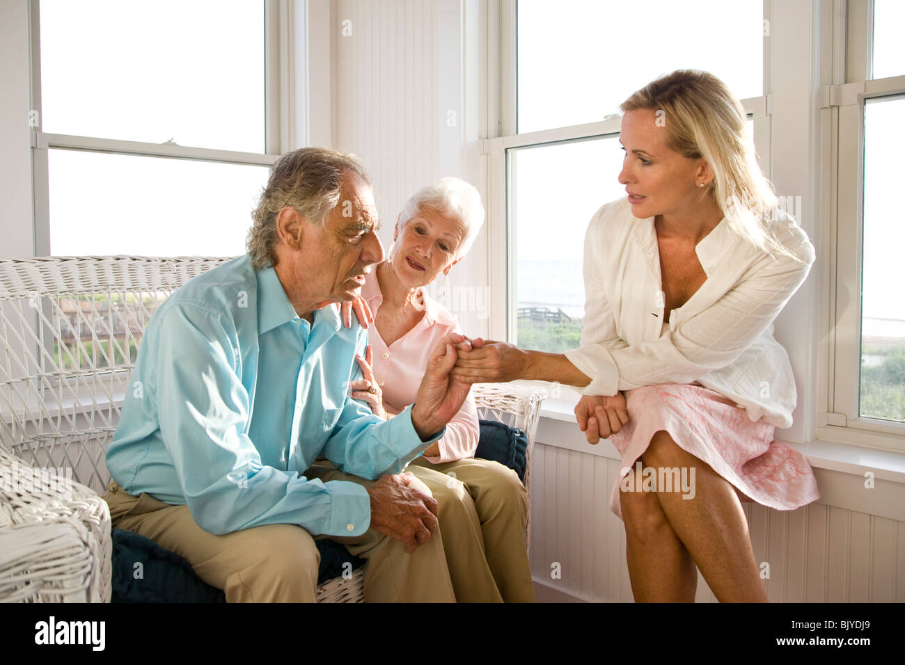Adult daughter having serious discussion with senior parents Stock Photo