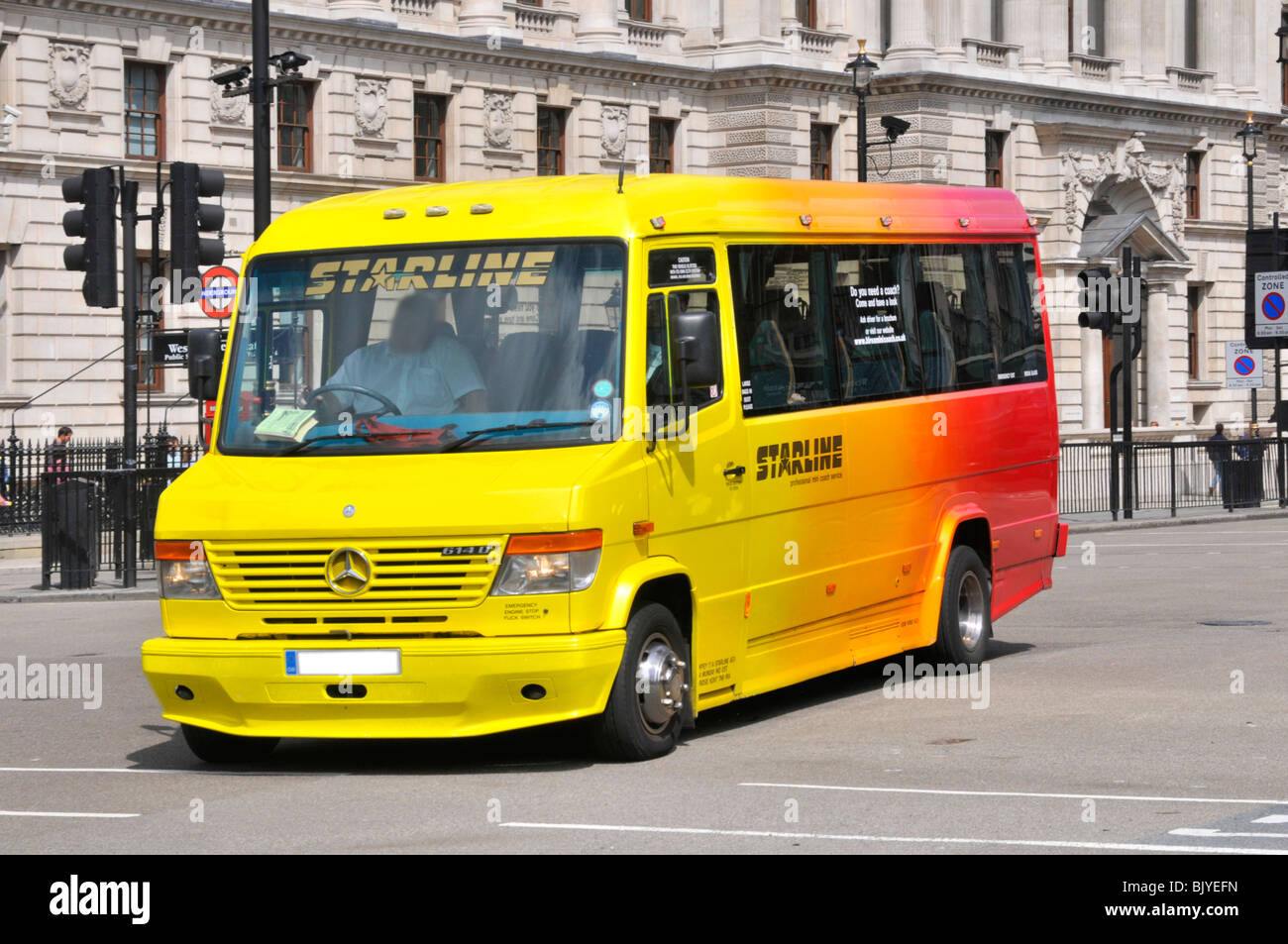 Mini coach bus and driver - Stock Image