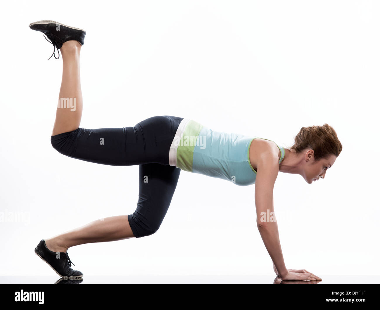 doing workout on white isolated background - Stock Image
