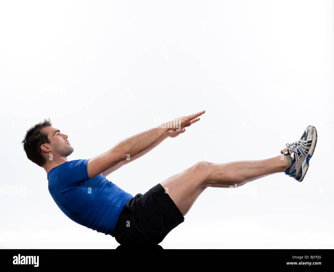 man on Abdominals workout posture on white background. Spice it up. This time bring your thighs to vertical and - Stock Image