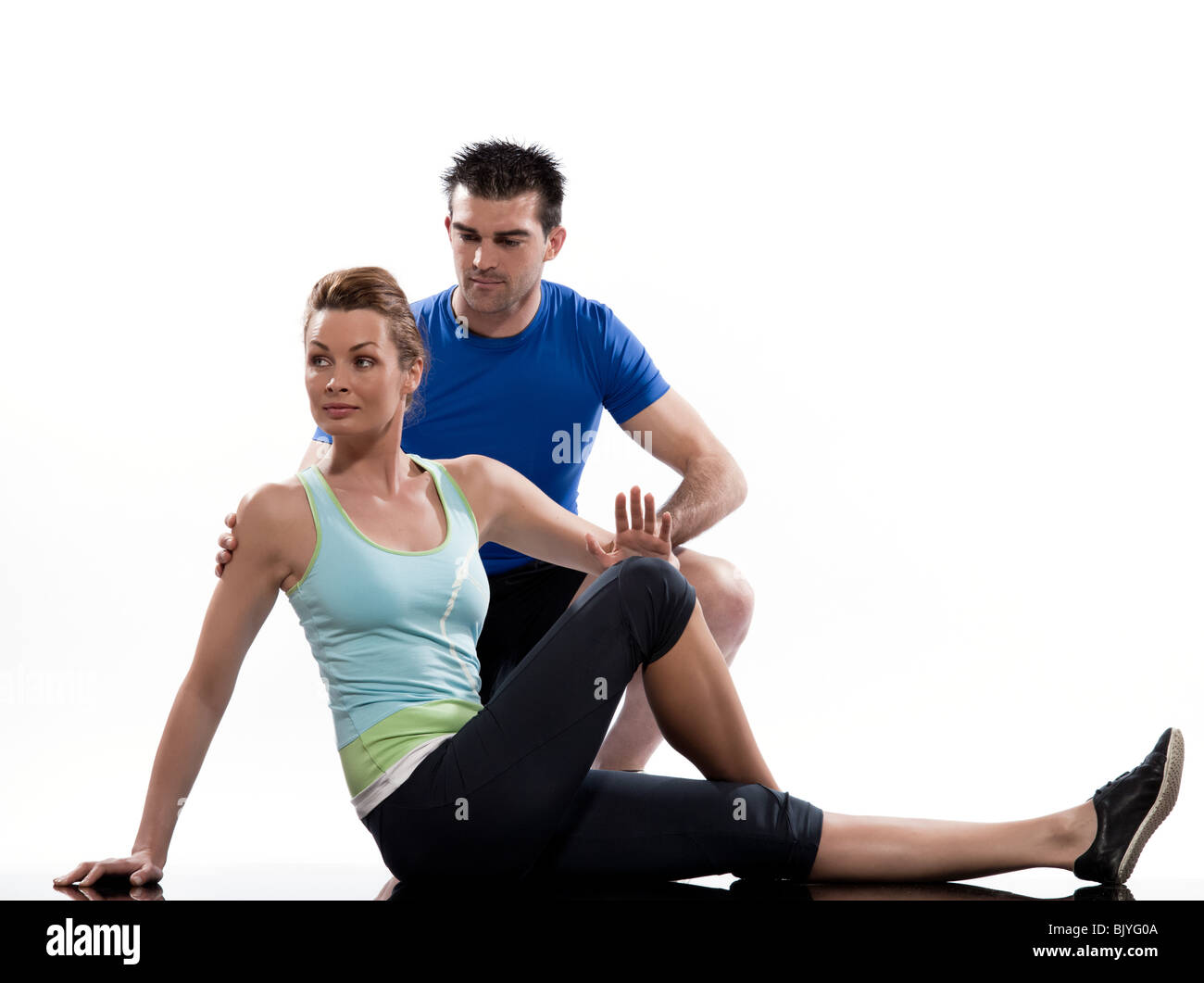 one caucasian couple man aerobic trainer positioning woman  Workout coach Posture in indoors studio isolated on - Stock Image