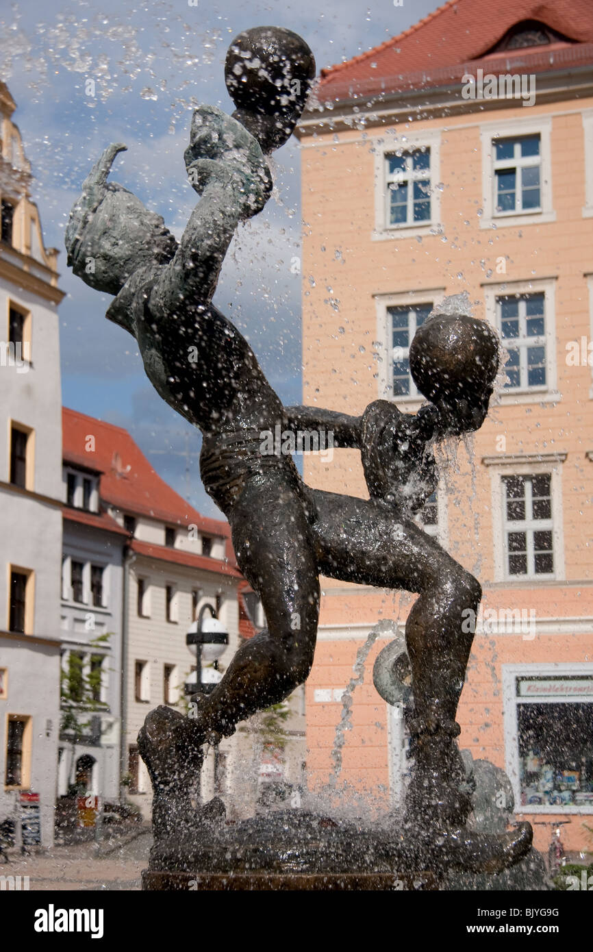 A fountain of a man juggling with balls in Torgau Saxony Germany Stock Photo
