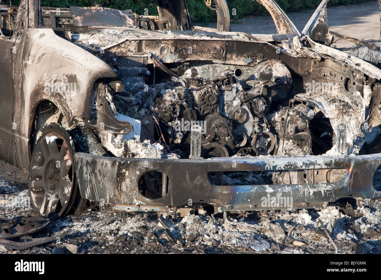 Engine, torched 'compact' pickup. - Stock Image