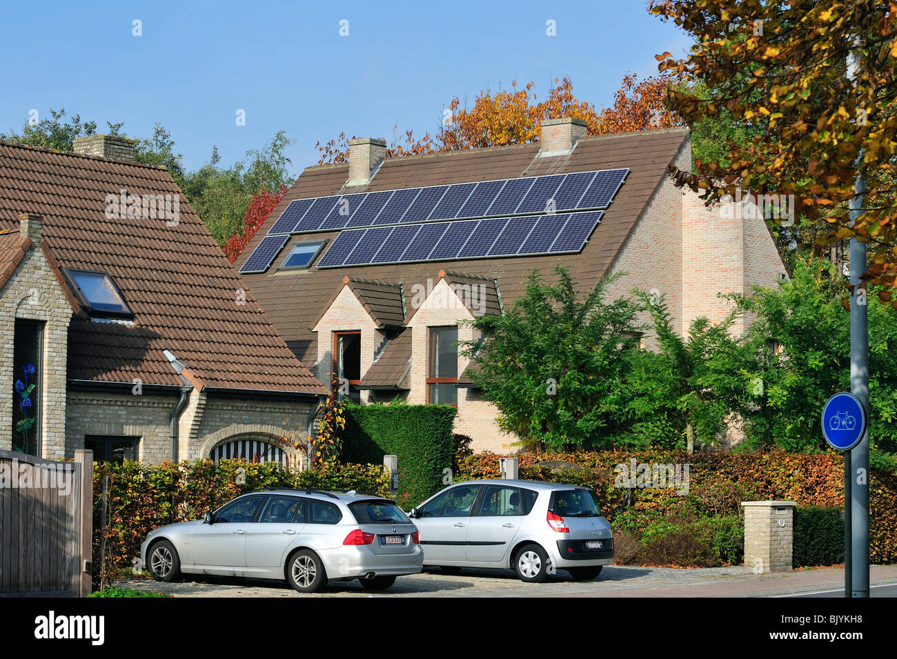 Photovoltaic solar panels on roof of house - Stock Image