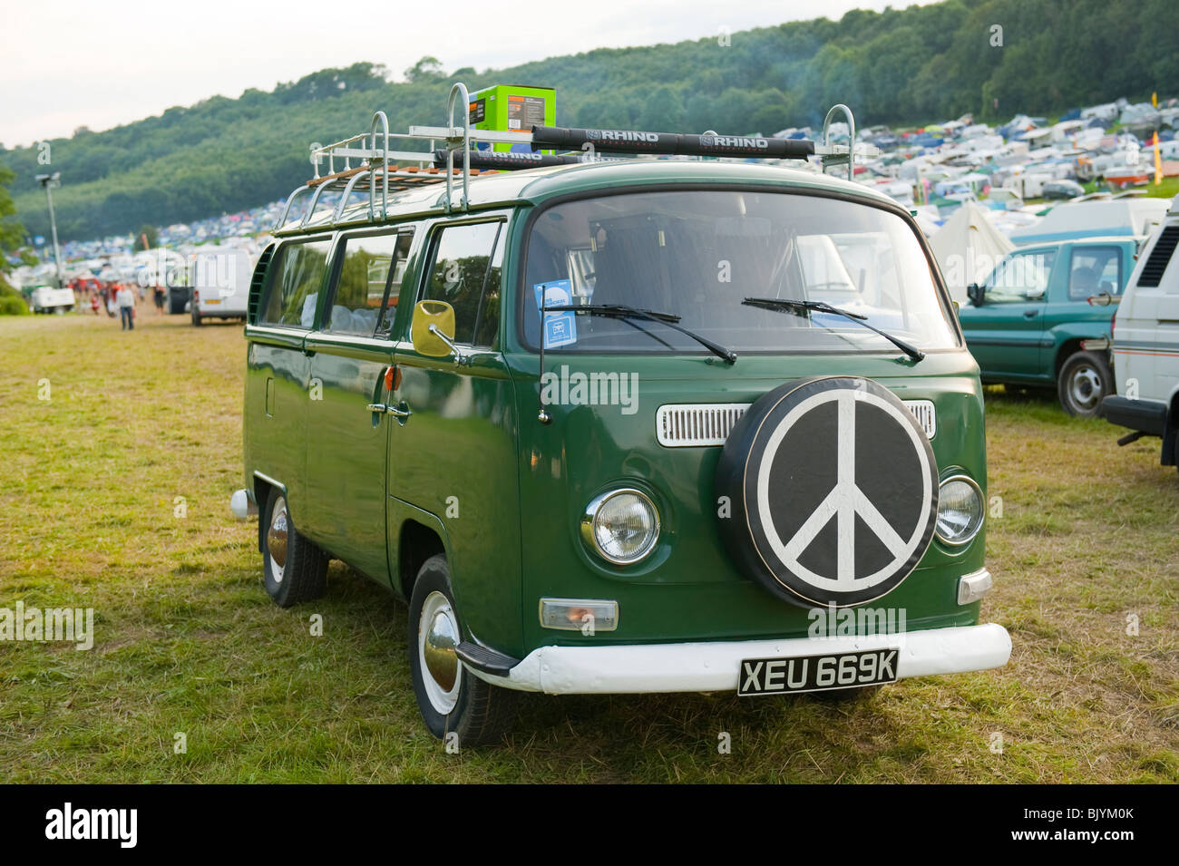 Old Green Volkswagen Camper Van With CND Symbol