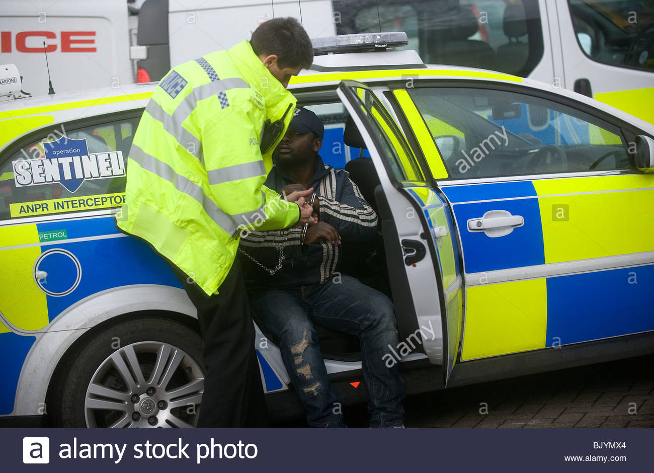 police arresting a male of African appearance - Stock Image