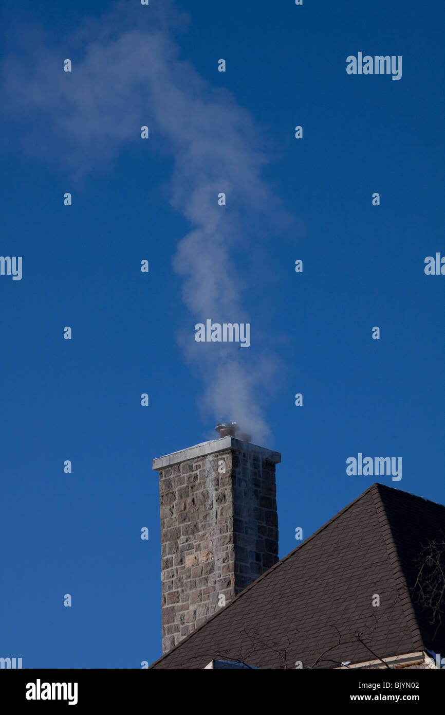 Exhaust coming from Chimney USA - Stock Image