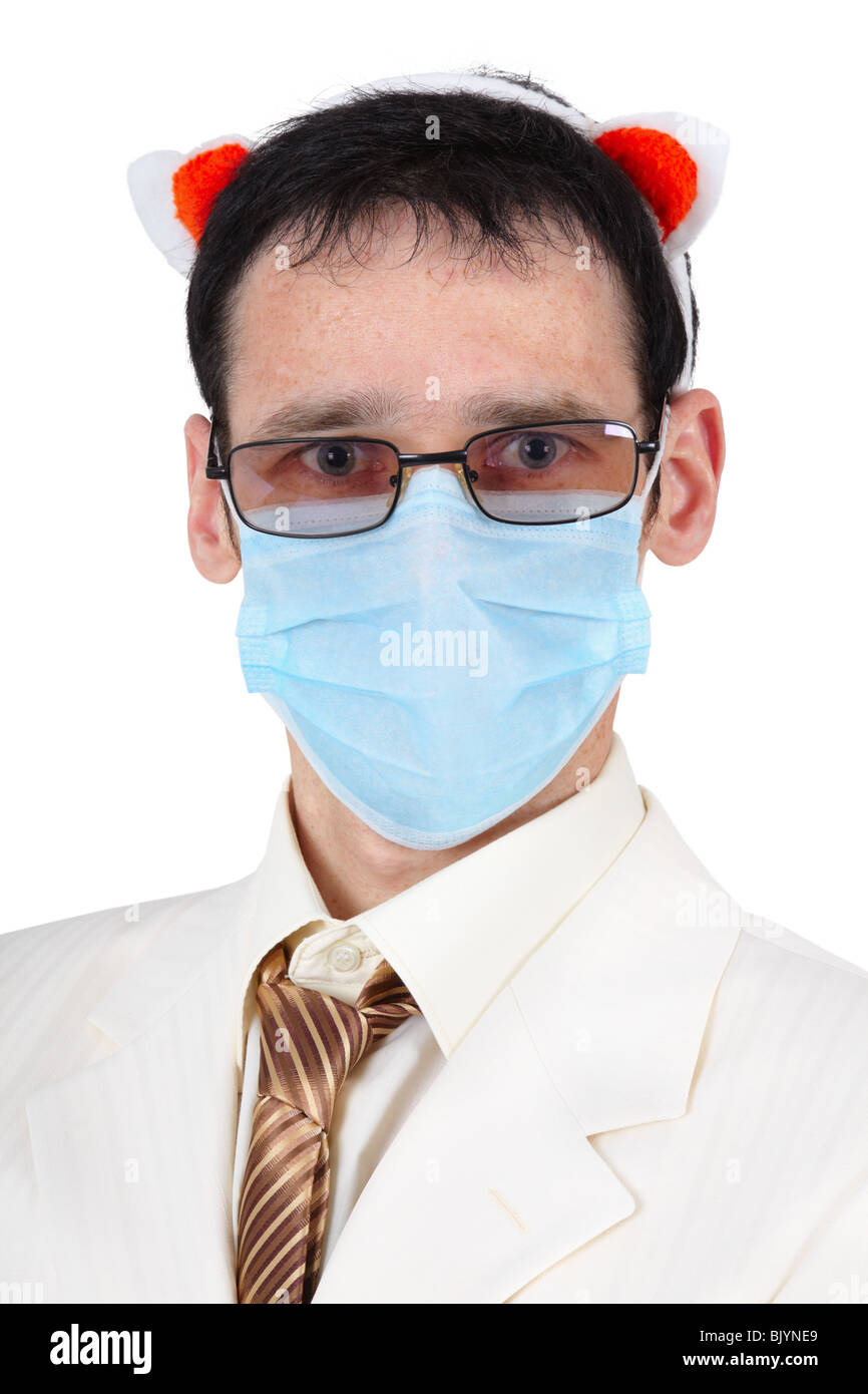 Funny guy in a medical mask and with pig ears - Stock Image