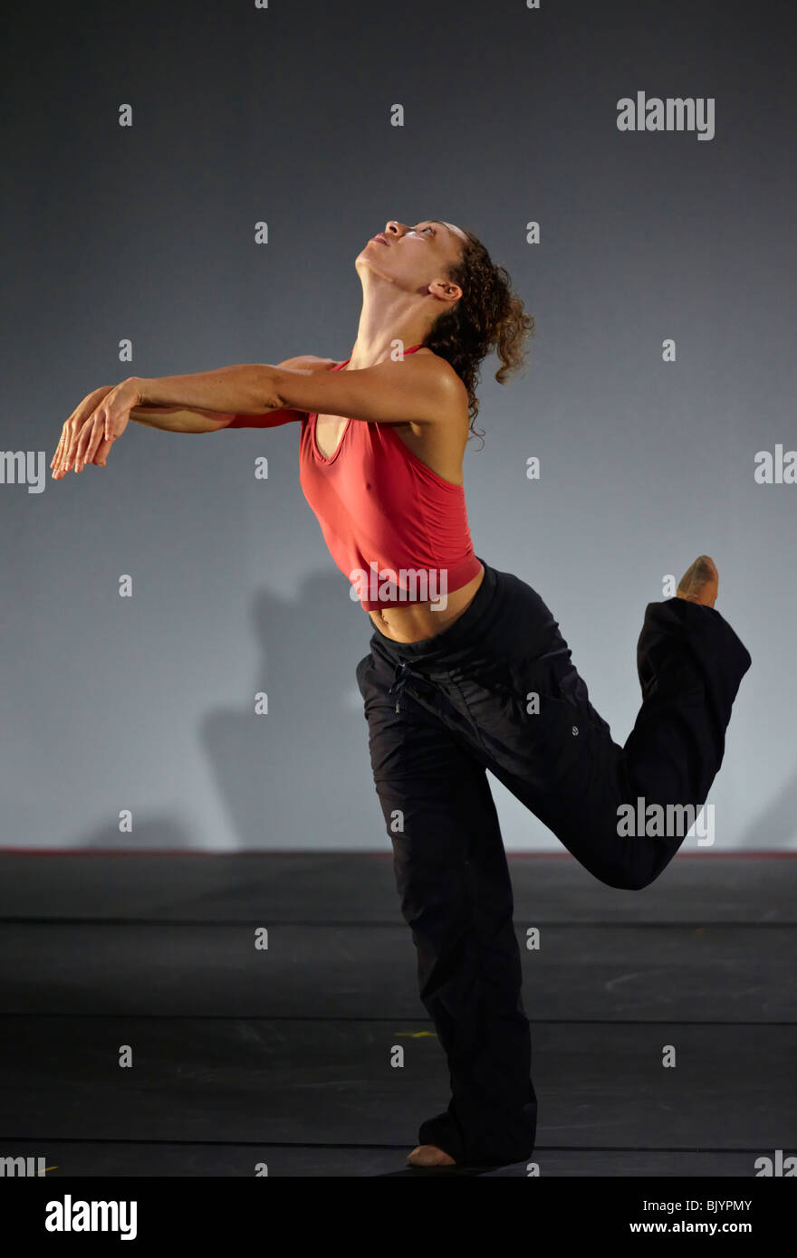 Female dancer of a modern dance performing group at a stage rehearsal. Thailand S. E. Asia Stock Photo