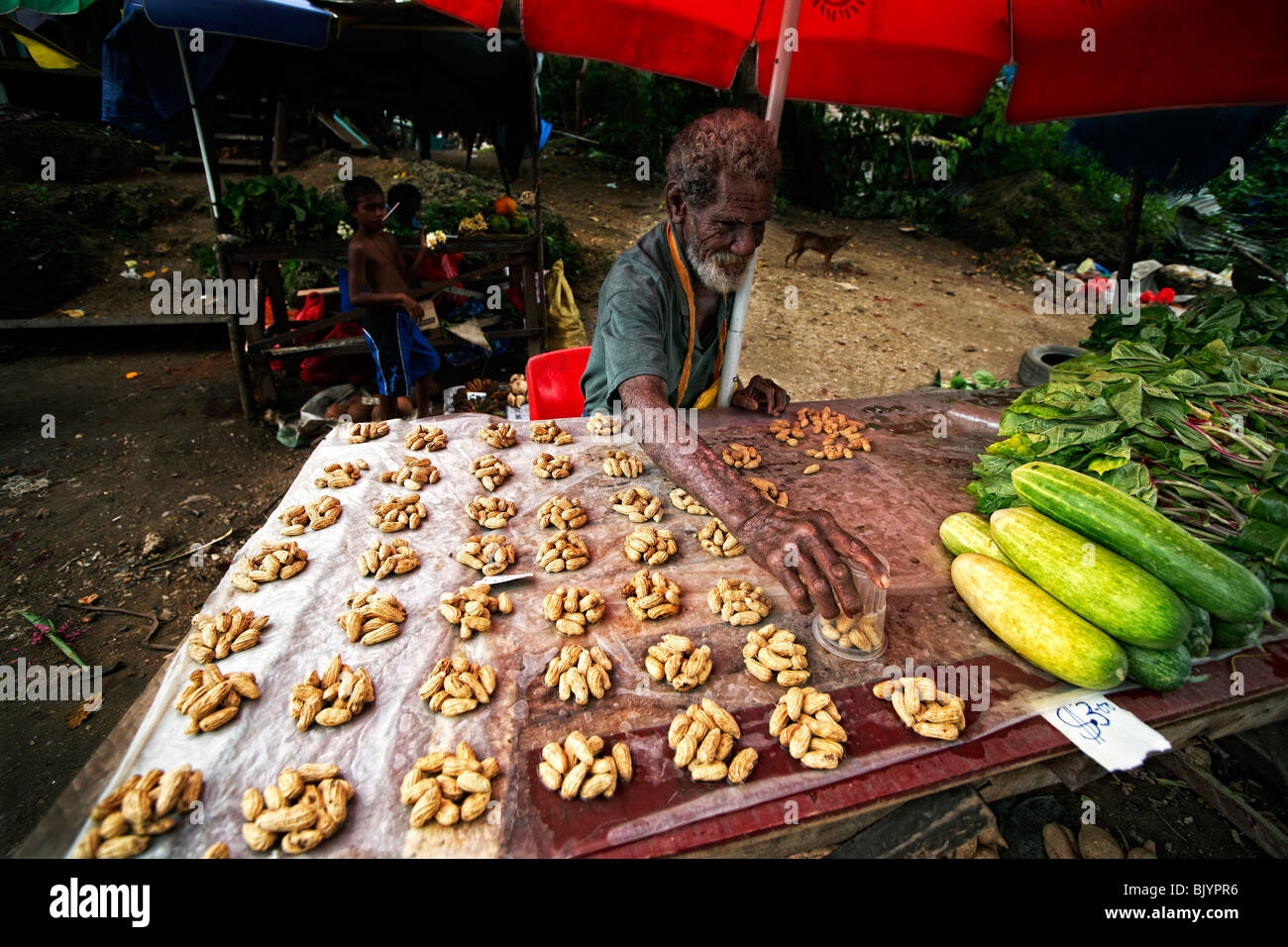 Peanut seller, roadside market, Solomon Islands - Stock Image
