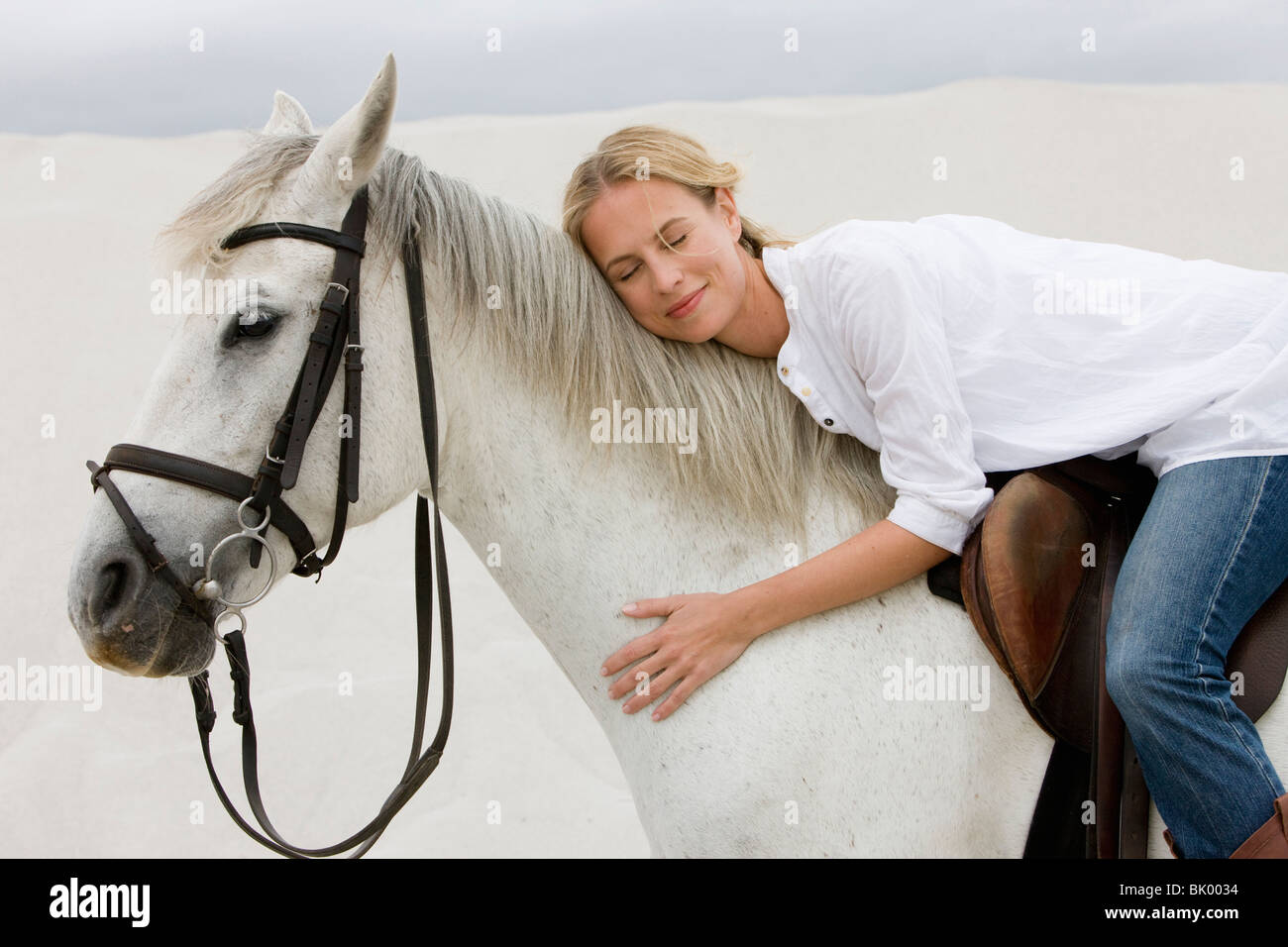 Horse with girl rider - Stock Image