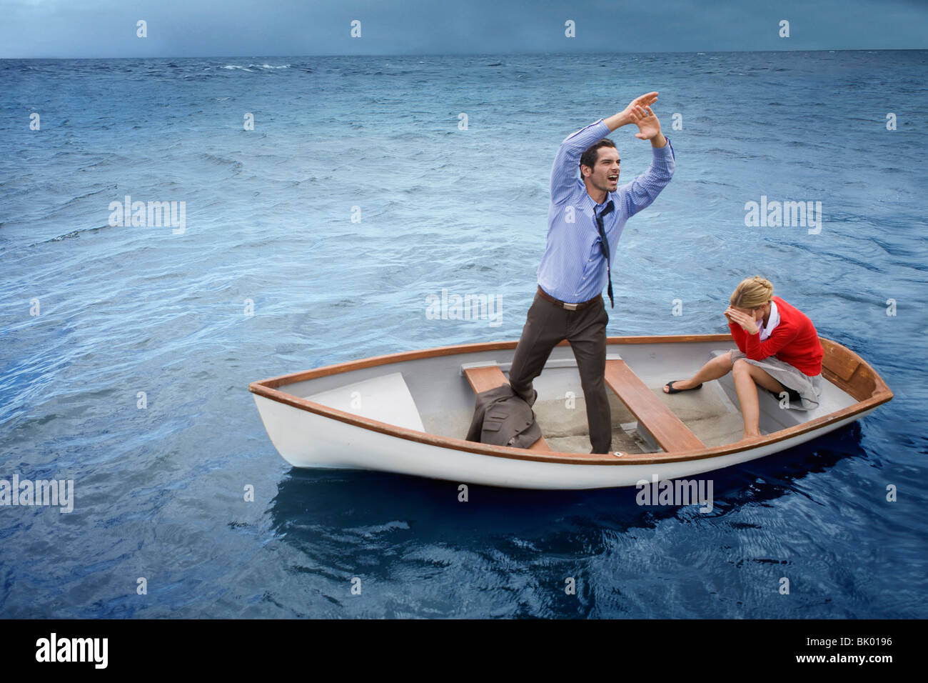 Couple in a disastrous situation Stock Photo