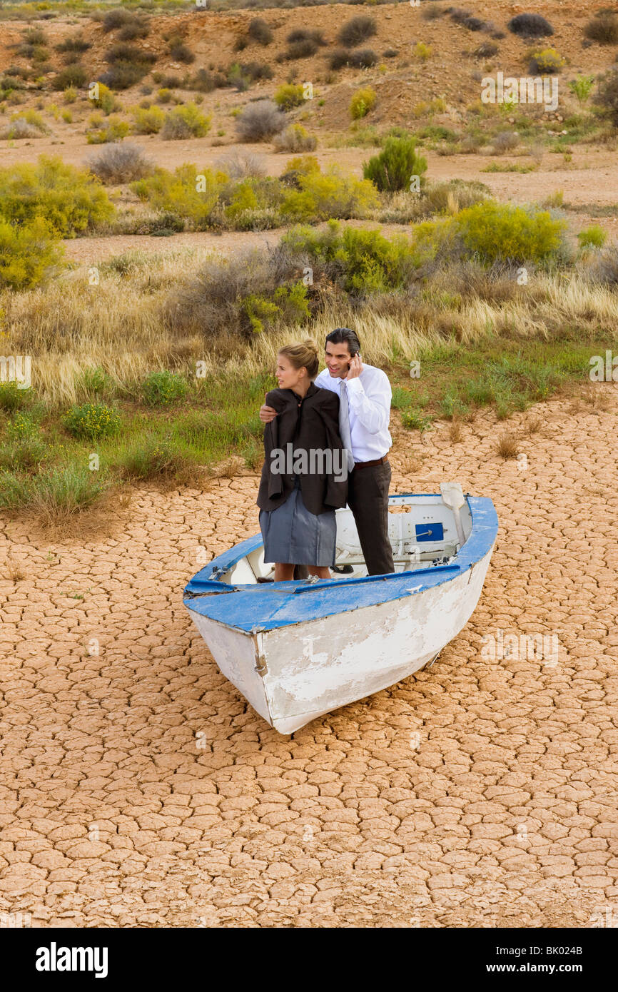 Business-couple lost in desert - Stock Image