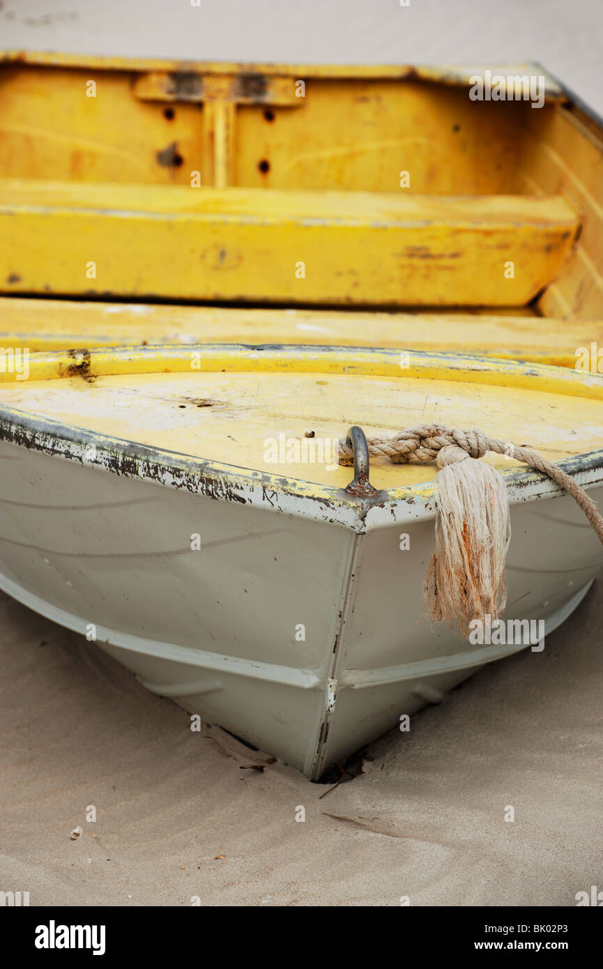An Aluminium Aluminum Boat Painted Yellow And Fading Rests