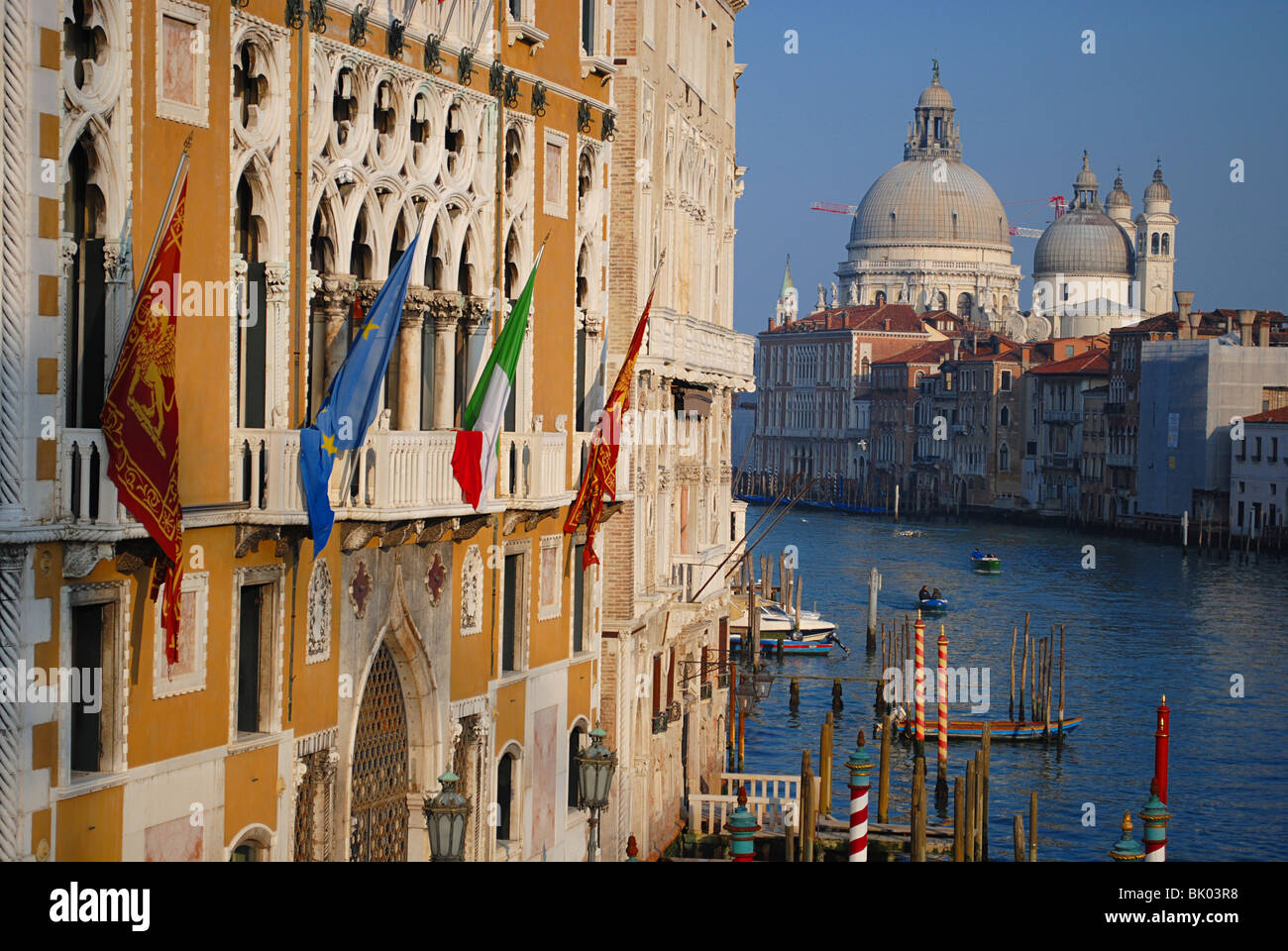 View of hotels and the Santa Maria della Salute church, from the Accademia bridge, Venice, Italy - Stock Image