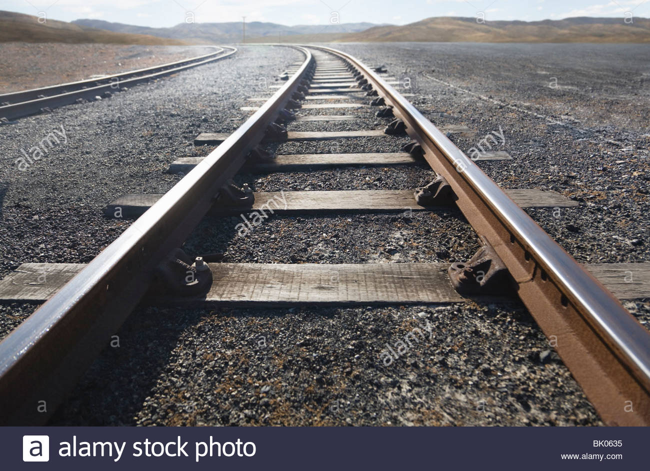 Train tracks stretching into distance - Stock Image